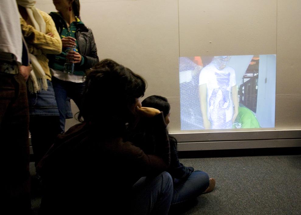 SPECTATORS WATCHING REGISTERINGAT THE EXHIBIT SPACE