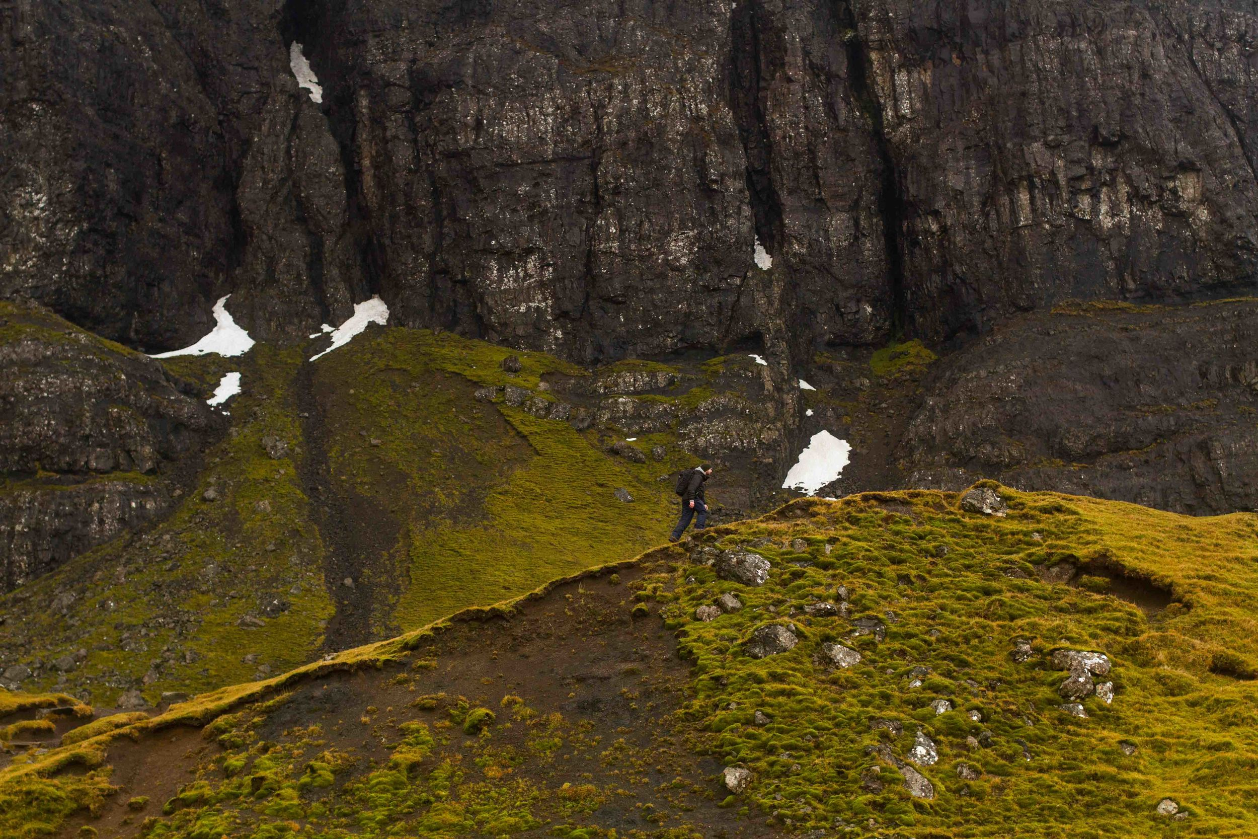 Richie walking up the ridge toward the Old Man of Storr