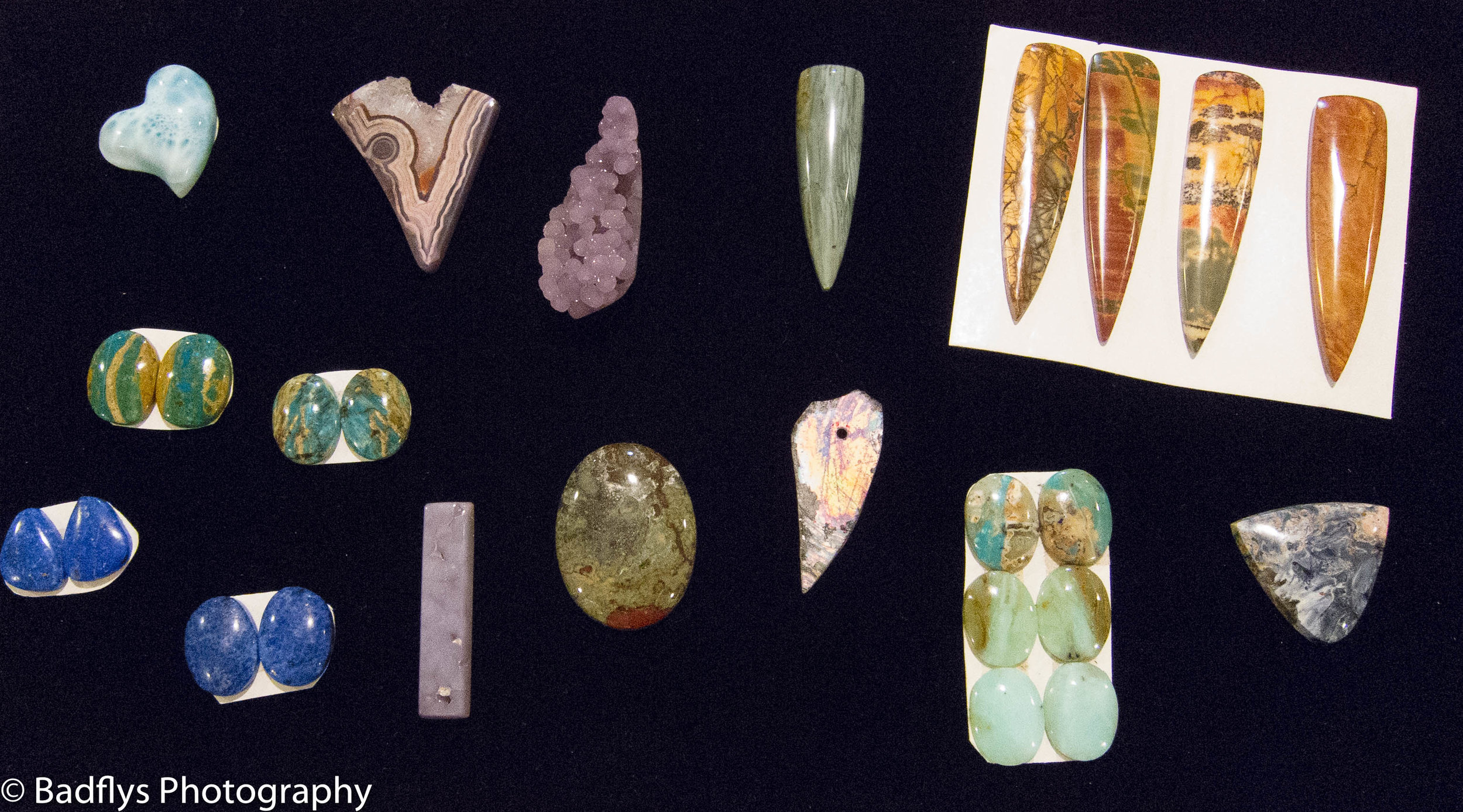 "Here is a selection of stones I've recently acquired. These will find their way into some new pieces I am creating. There's Larimar, Chrysocolla, Denim Lapis, Red Creek Jasper, Roman Glass, oh my! Had a lot of fun at the Denver Gem shows this September. Now I just have to ""get busy""!"