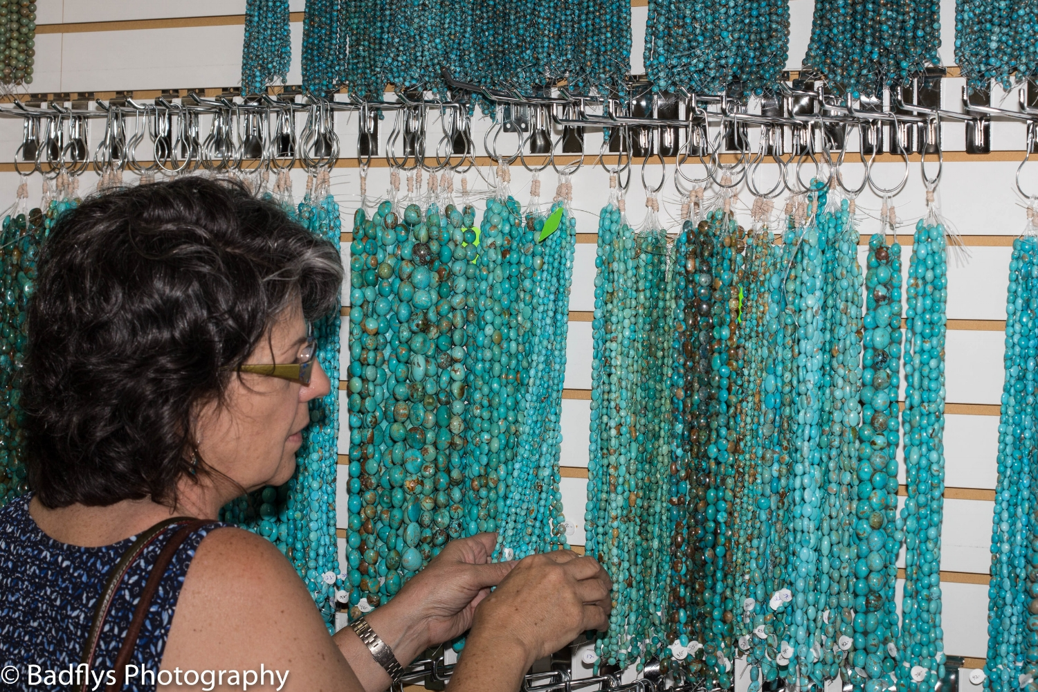 Picking through the turquoise beads to find the right ones