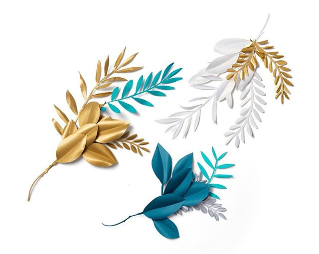 One of our, @partyofonestudio, first jobs under our then new name was to create and photograph a whole bunch of paper crafted olive, boxwood, and magnolia leaves and stems for this year's @moroccanoil holiday gift sets. 🕊 Just a peek here at one of the many little groupings. You can see the packaging finals on our @partyofonestudio feed 💫