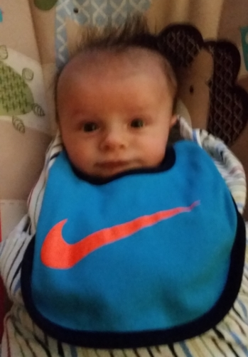 For those of you who are here to simply see an updated picture of William.  Here he is sporting his Nike bib after a midnight feeding.  Who needs sleep, anyway?  Not William (apparently).