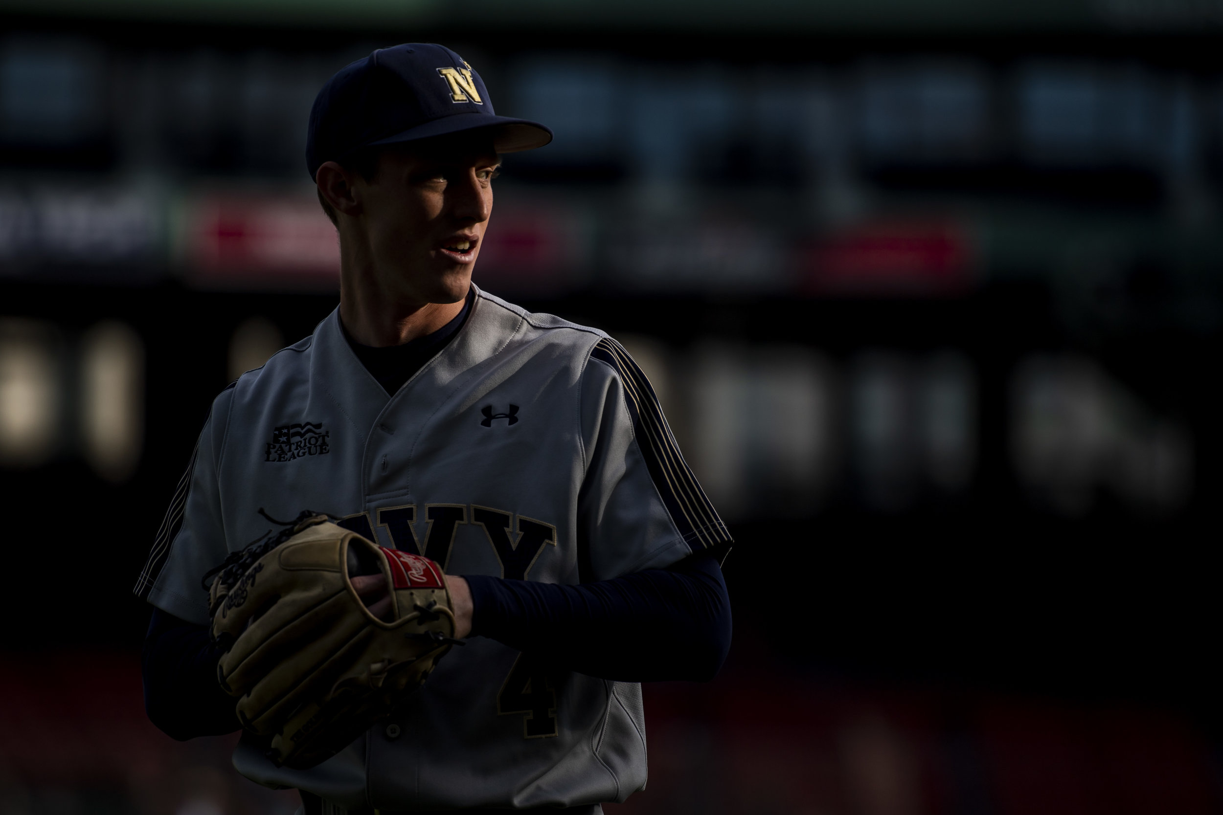 April 20, 2018, Boston, MA: A Navy player warms up in the outfield before Army - West Point faces The Naval Academy at Fenway Park in Boston, Massachusetts Friday, April 20, 2018. (Photo by Matthew Thomas/Boston Red Sox)