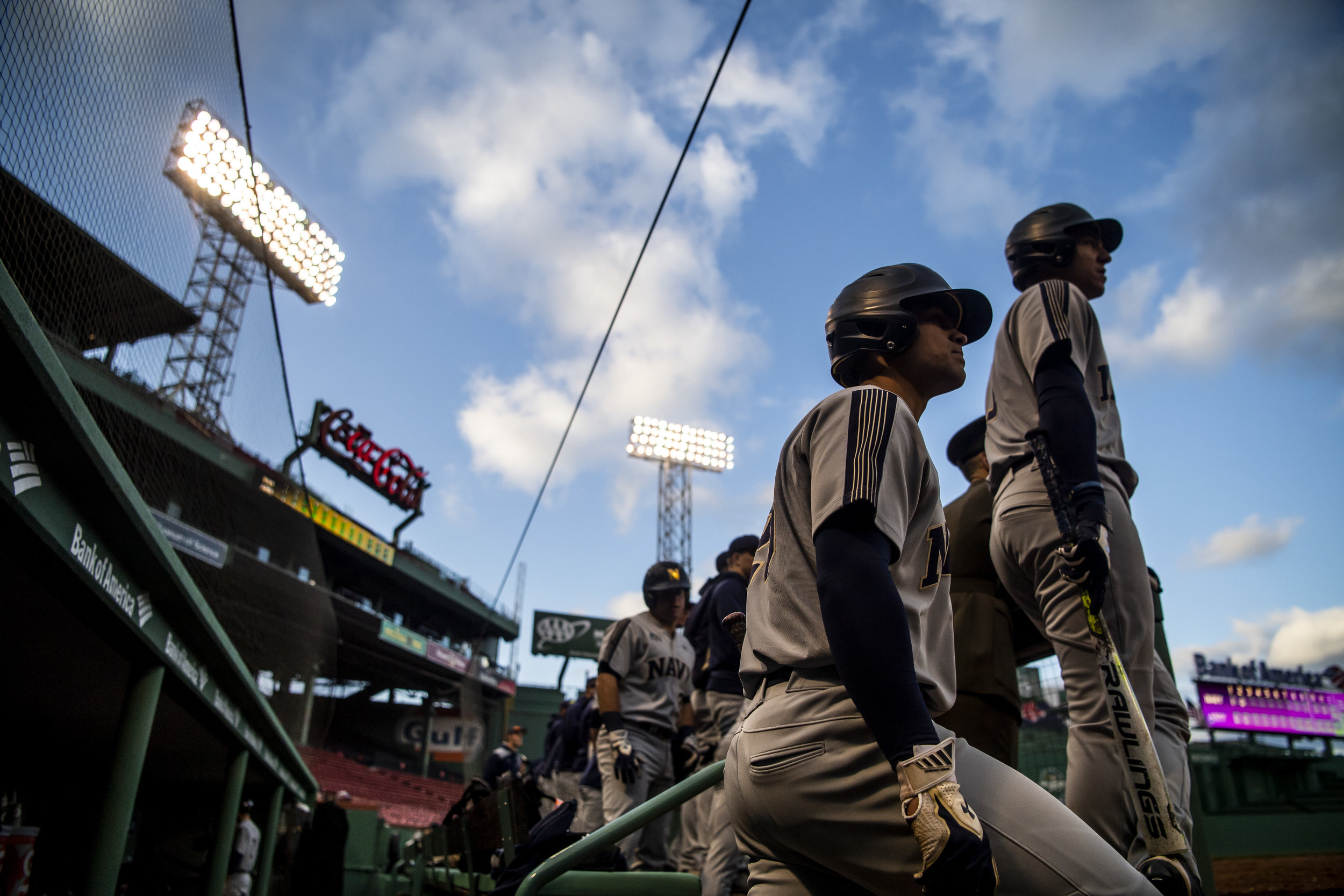 April 20, 2018, Boston, MA: The Navy team stands in the dugout waiting to bat as Army - West Point faces The Naval Academy at Fenway Park in Boston, Massachusetts Friday, April 20, 2018. (Photo by Matthew Thomas/Boston Red Sox)
