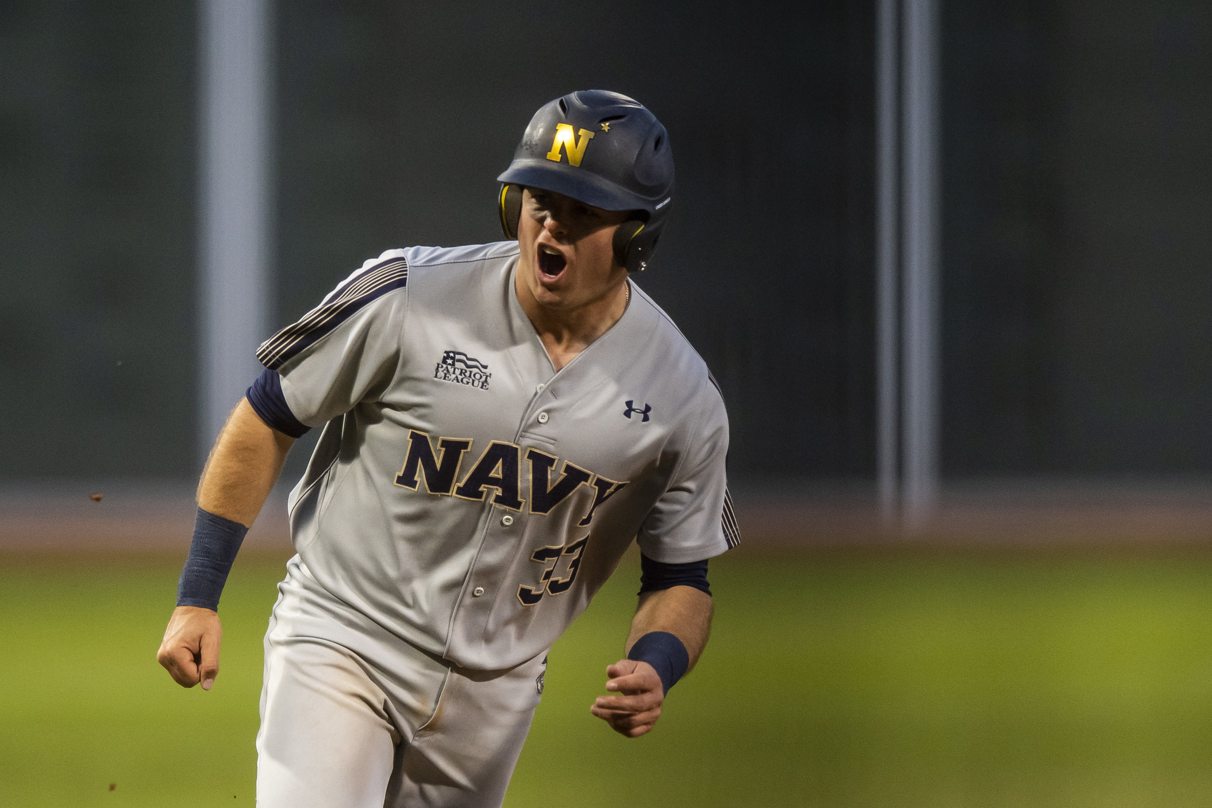 April 20, 2018, Boston, MA: A navy player celebrates after hitting a home run as Army - West Point faces The Naval Academy at Fenway Park in Boston, Massachusetts Friday, April 20, 2018. (Photo by Matthew Thomas/Boston Red Sox)