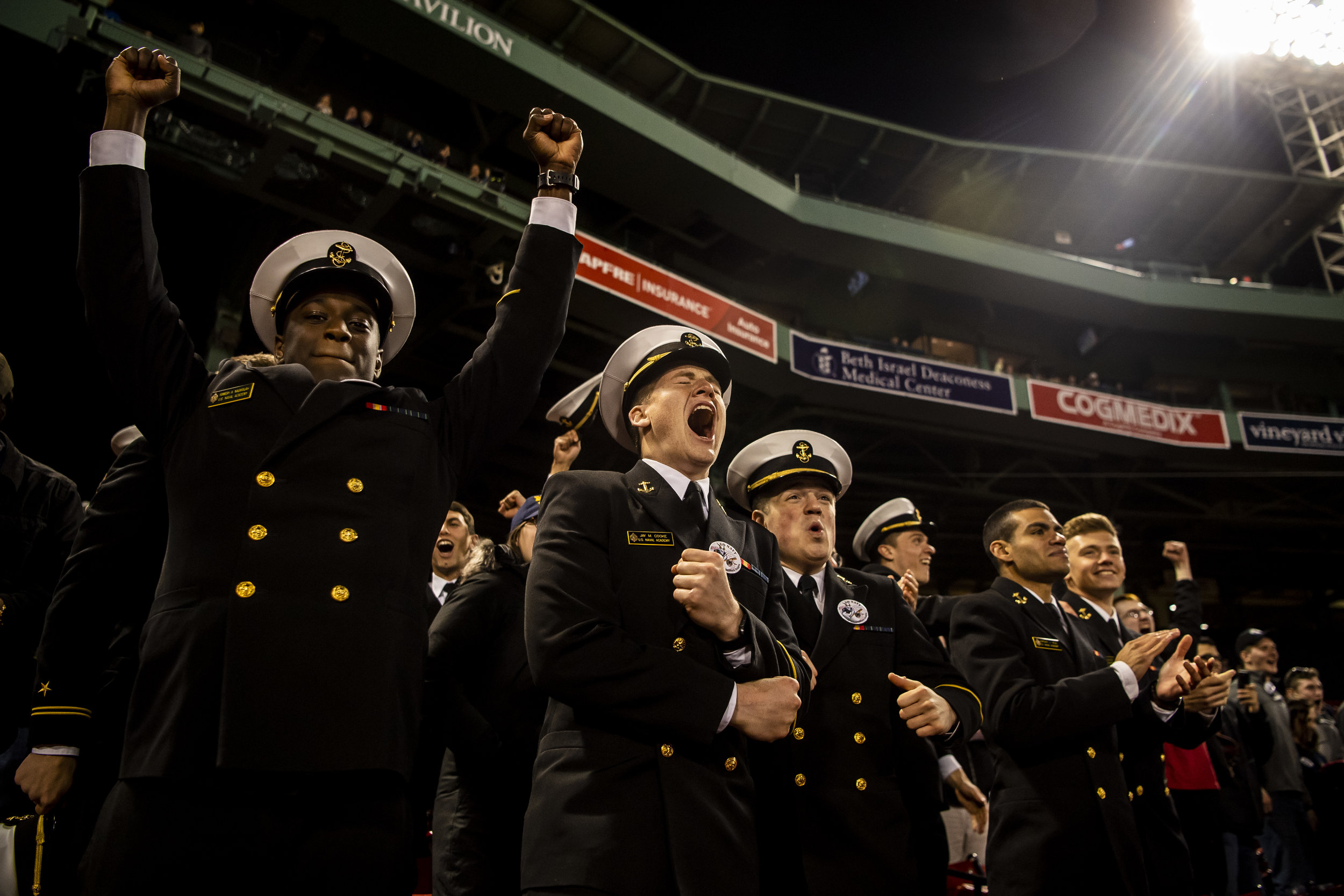 April 20, 2018, Boston, MA: Navy cadets clap and celebrate after the game as Army - West Point lost to The Naval Academy at Fenway Park in Boston, Massachusetts Friday, April 20, 2018. (Photo by Matthew Thomas/Boston Red Sox)