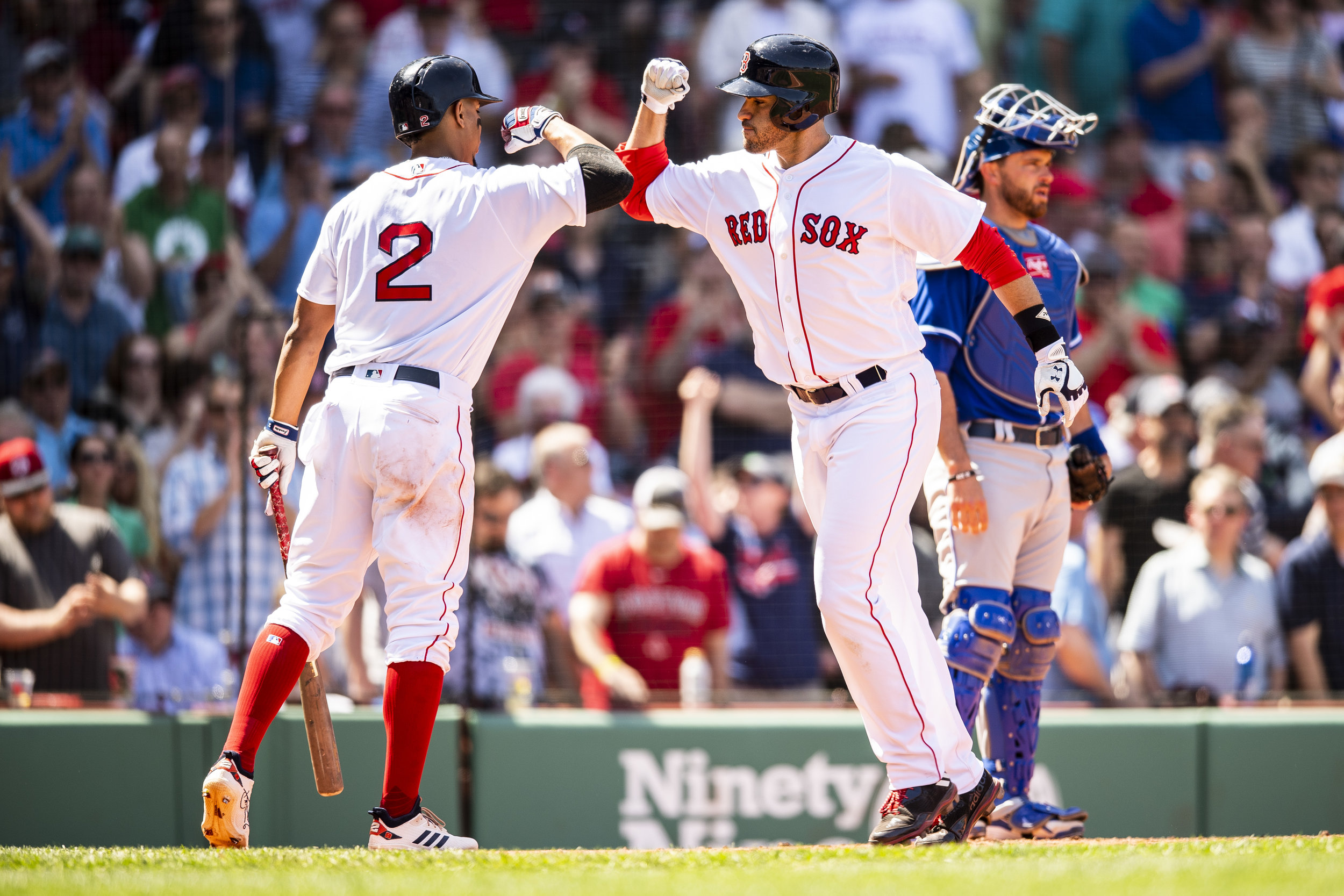 May 2, 2018, Boston, MA: Boston Red Sox designated hitter J.D. Martinez high fives Boston Red Sox shortstop Xander Bogaerts after hitting a home run as the Boston Red Sox face the Kansas City Royals at Fenway Park in Boston, Massachusetts Wednesday, May 2, 2018. (Photo by Matthew Thomas/Boston Red Sox)