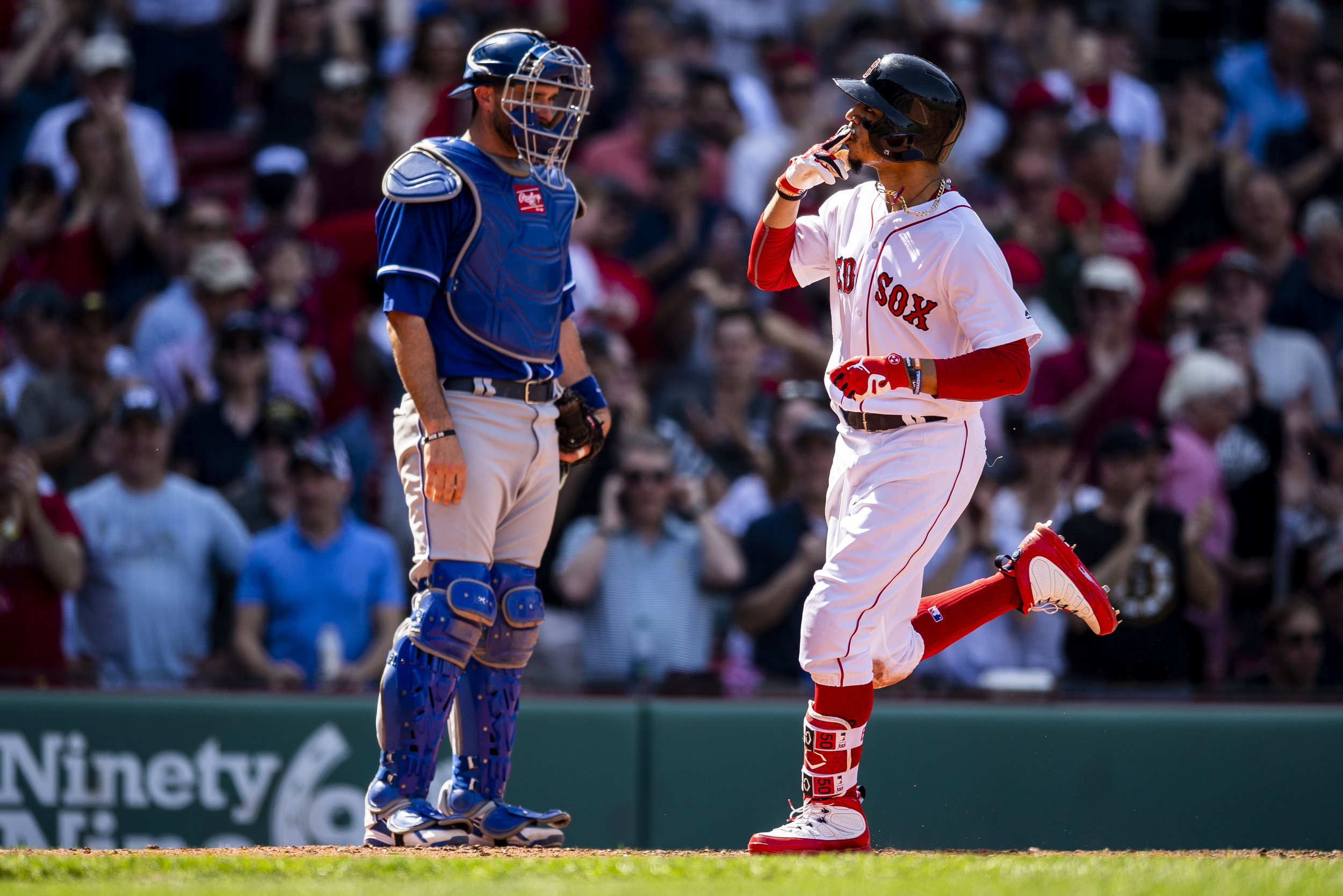 May 2, 2018, Boston, MA: Boston Red Sox outfielder Mookie Betts crosses the plate and celebrates after hitting his third home run of the game as the Boston Red Sox face the Kansas City Royals at Fenway Park in Boston, Massachusetts Wednesday, May 2, 2018. (Photo by Matthew Thomas/Boston Red Sox)