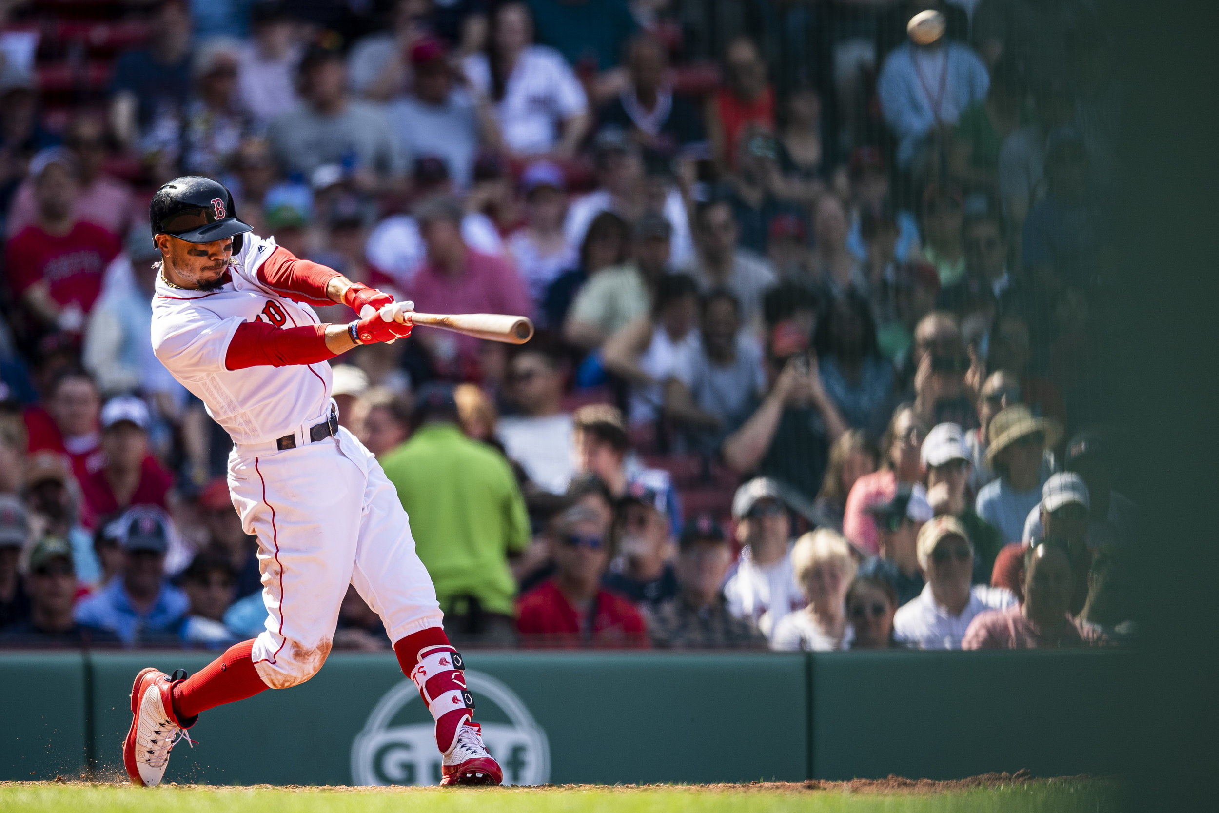 May 2, 2018, Boston, MA: Boston Red Sox outfielder Mookie Betts swings and hits his third home run of the game as the Boston Red Sox face the Kansas City Royals at Fenway Park in Boston, Massachusetts Wednesday, May 2, 2018. (Photo by Matthew Thomas/Boston Red Sox)