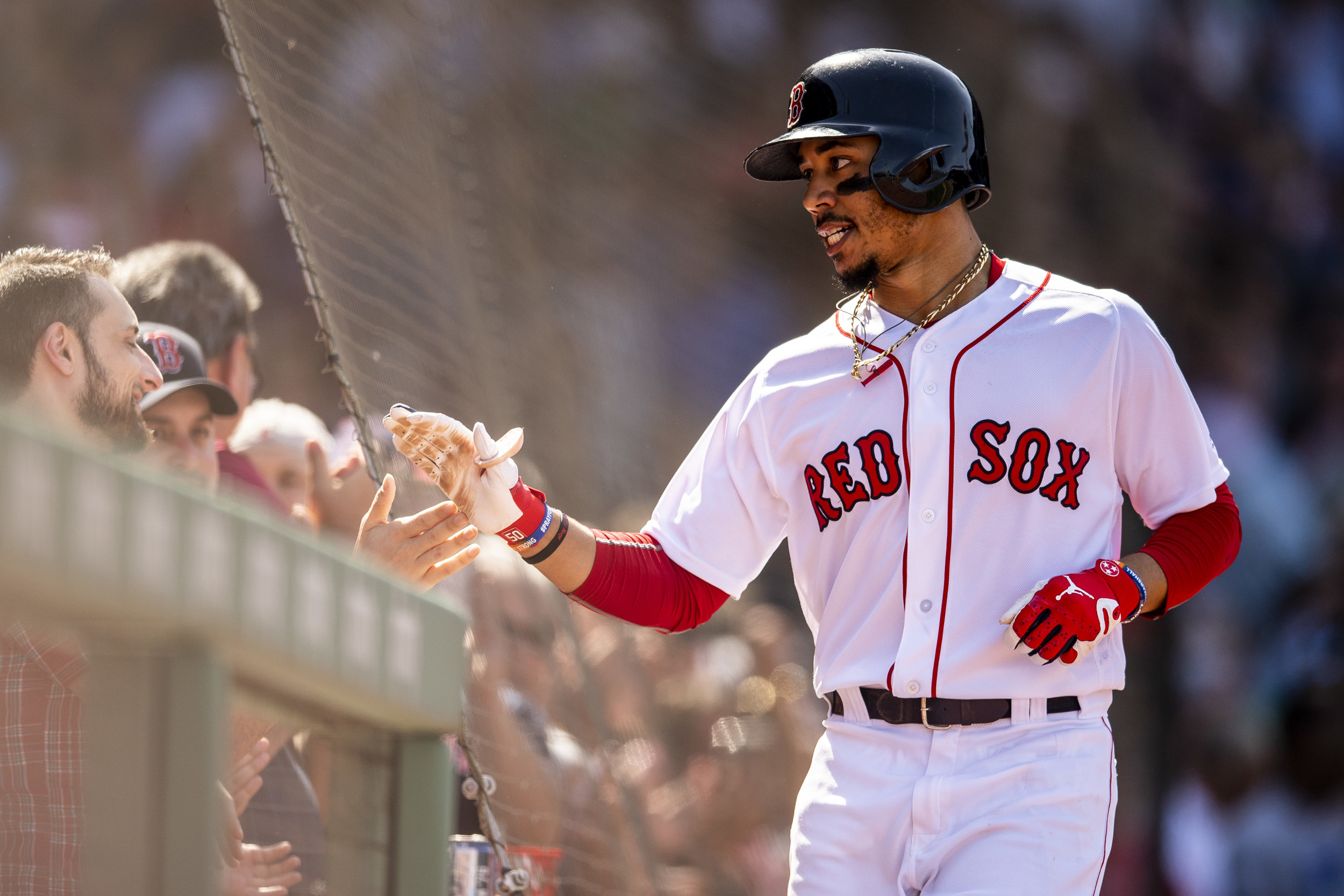 May 2, 2018, Boston, MA: Boston Red Sox outfielder Mookie Betts high fives fans after hitting his third home run of the game as the Boston Red Sox face the Kansas City Royals at Fenway Park in Boston, Massachusetts Wednesday, May 2, 2018. (Photo by Matthew Thomas/Boston Red Sox)