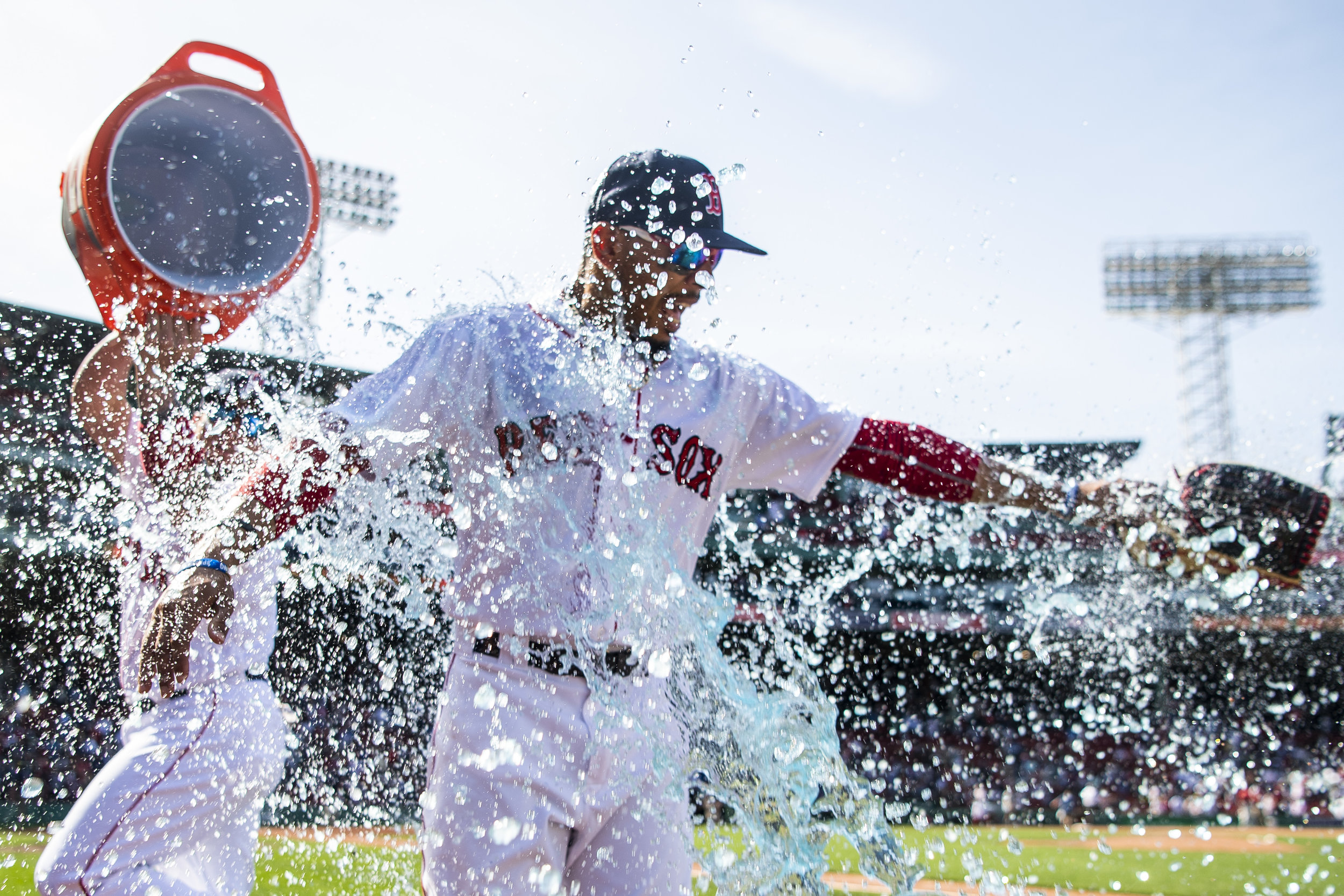 May 2, 2018, Boston, MA: Boston Red Sox catcher Christian Vasquez dumps a cooler of Gatorade on Boston Red Sox outfielder Mookie Betts after the Boston Red Sox defeated the Kansas City Royals at Fenway Park in Boston, Massachusetts Wednesday, May 2, 2018. (Photo by Matthew Thomas/Boston Red Sox)