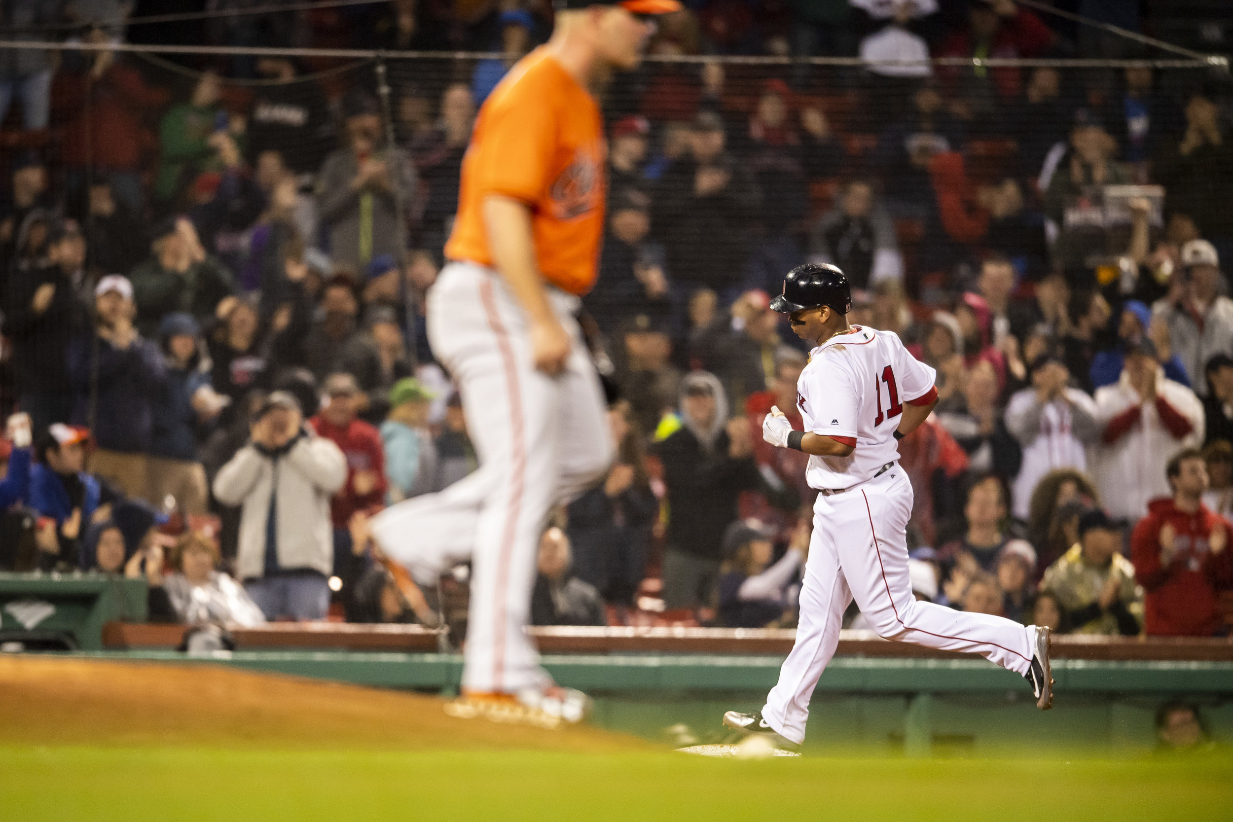 May 19, 2018, Boston, MA: Boston Red Sox third basemen Rafael Devers trots around third base after hitting a home run as the Boston Red Sox face the Baltimore Orioles at Fenway Park in Boston, Massachusetts on Saturday, May 19, 2018. (Photo by Matthew Thomas/Boston Red Sox)