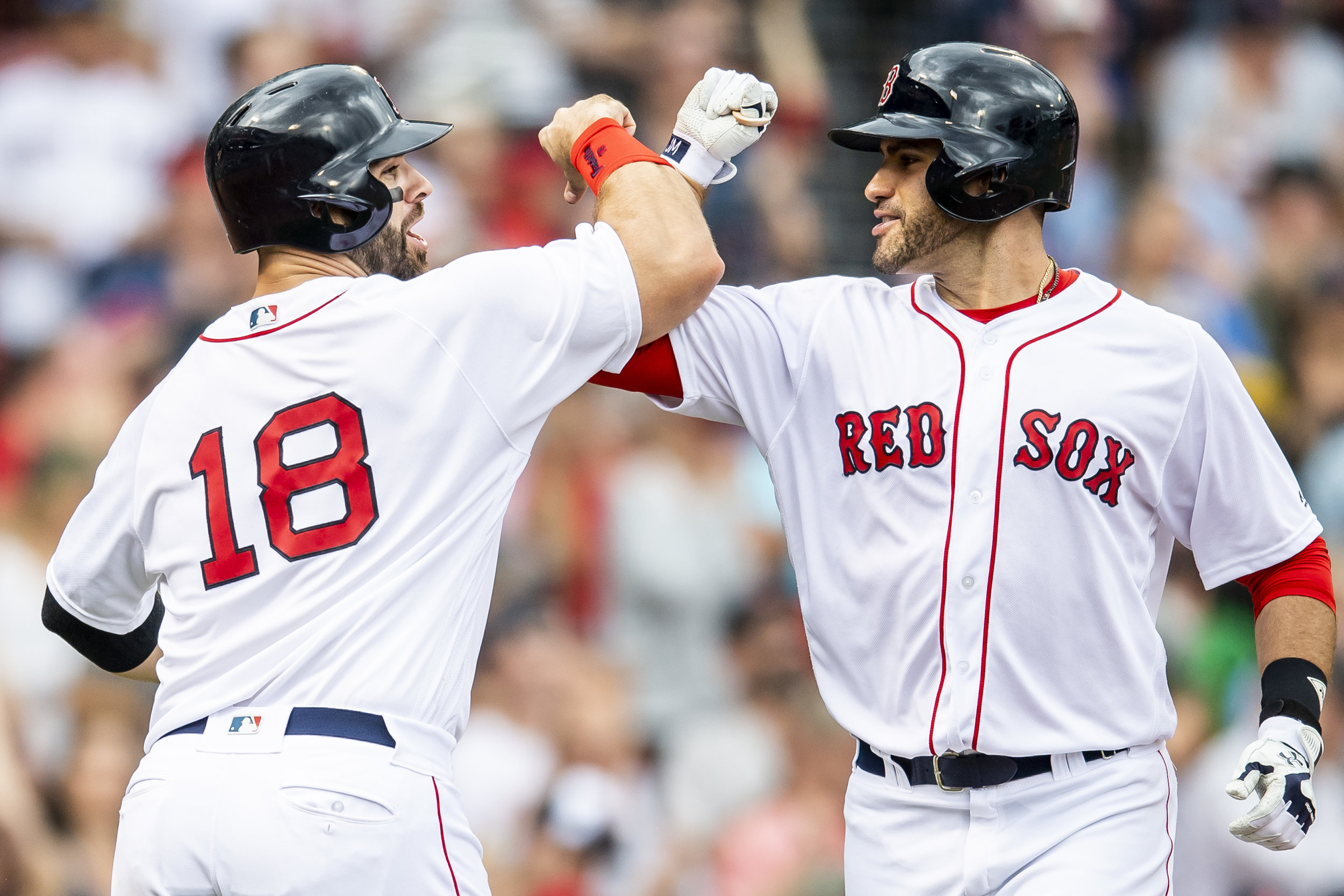 May 20, 2018, Boston, MA: Boston Red Sox designated hitter J.D. Martinez celebrates hitting a home run with Boston Red Sox first basemen Mitch Moreland as the Boston Red Sox face the Baltimore Orioles at Fenway Park in Boston, Massachusetts on Saturday, May 20, 2018. (Photo by Matthew Thomas/Boston Red Sox)