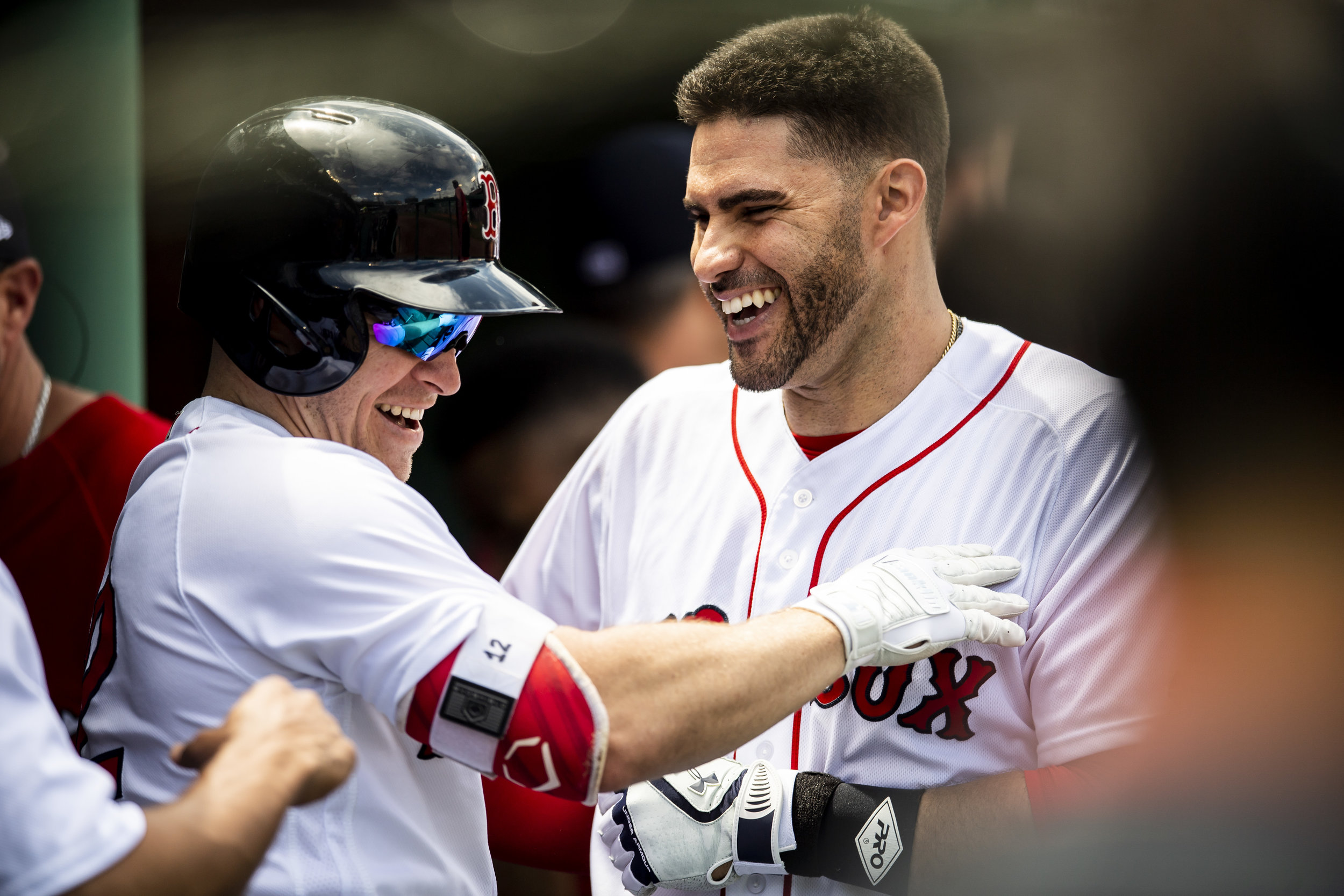 May 20, 2018, Boston, MA: Boston Red Sox J.D. Martinez hugs Boston Red Sox shortstop Brock Holt in the dugout after hitting a home run as the Boston Red Sox face the Baltimore Orioles at Fenway Park in Boston, Massachusetts on Saturday, May 20, 2018. (Photo by Matthew Thomas/Boston Red Sox)