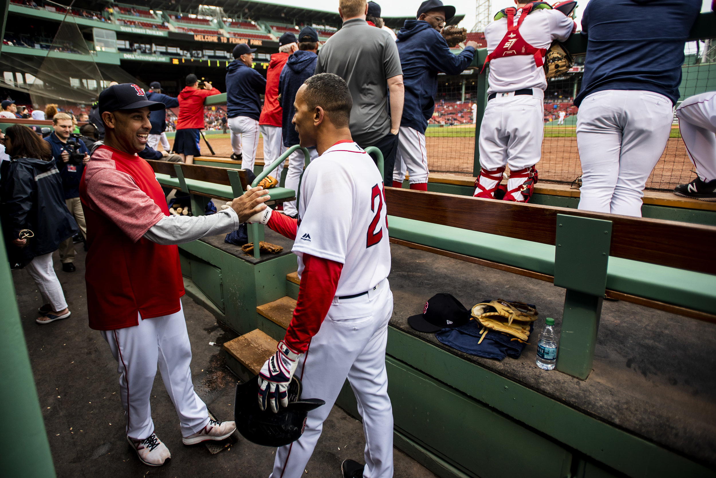 May 27, 2018, Boston, MA: Red Sox Manager Alex Core high-fives former Red Sox infielder Julio Lugo after he hit a home run during the Red Alumni Game at Fenway Park in Boston, Massachusetts on Sunday, May 27, 2018. (Photo by Matthew Thomas/Boston Red Sox)