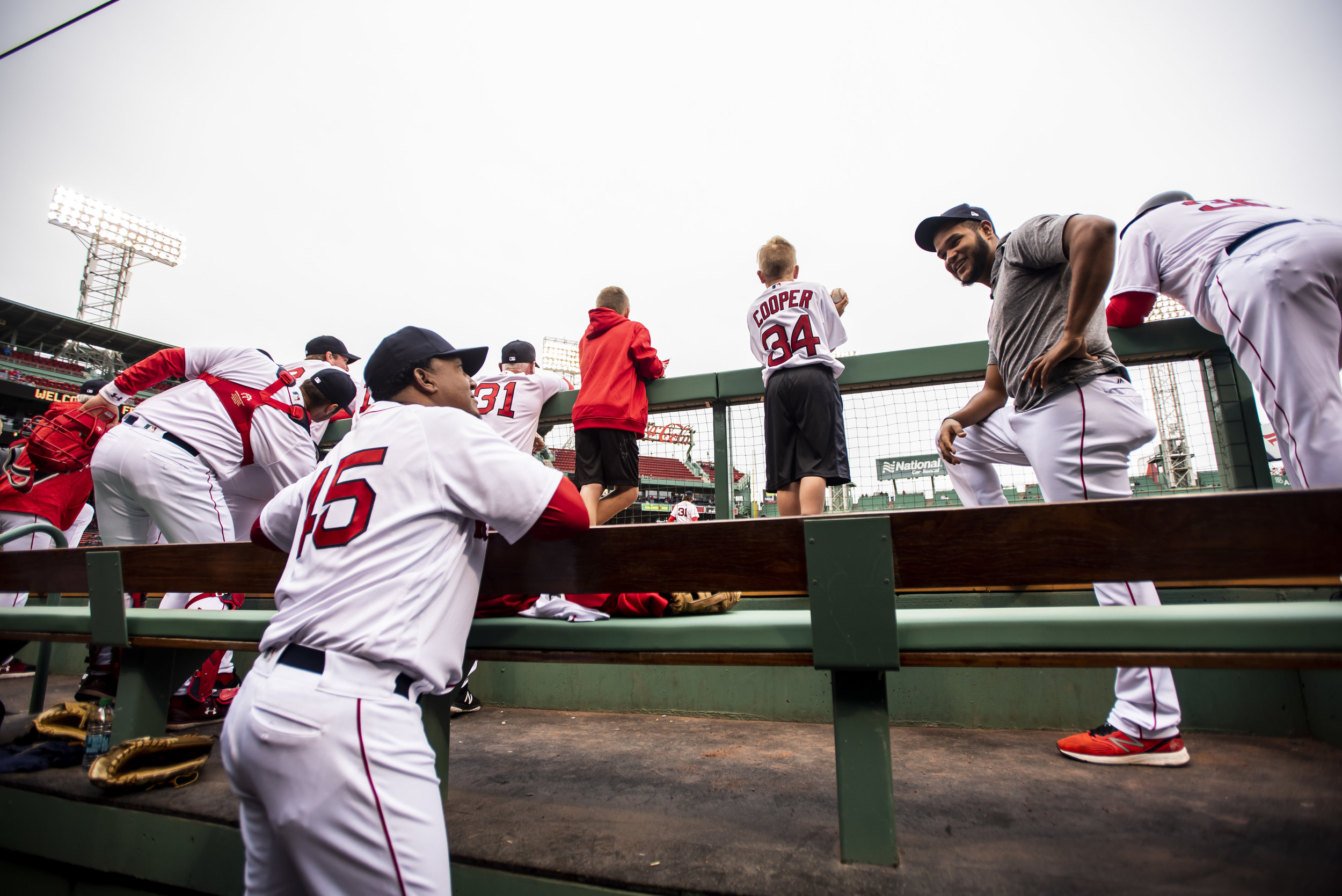 May 27, 2018, Boston, MA: Boston Red Sox pitcher Eduardo Rodriguez chats with Pedro Martinez in the dugout during Alumni Game at Fenway Park in Boston, Massachusetts on Sunday, May 27, 2018. (Photo by Matthew Thomas/Boston Red Sox)