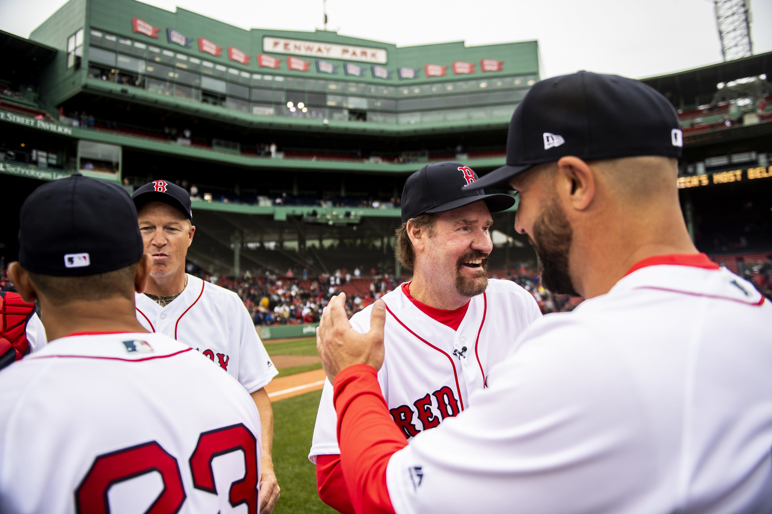 May 27, 2018, Boston, MA: Wade Boggs high fives his teammates after the Red Sox Alumni Game at Fenway Park in Boston, Massachusetts on Sunday, May 27, 2018. (Photo by Matthew Thomas/Boston Red Sox)