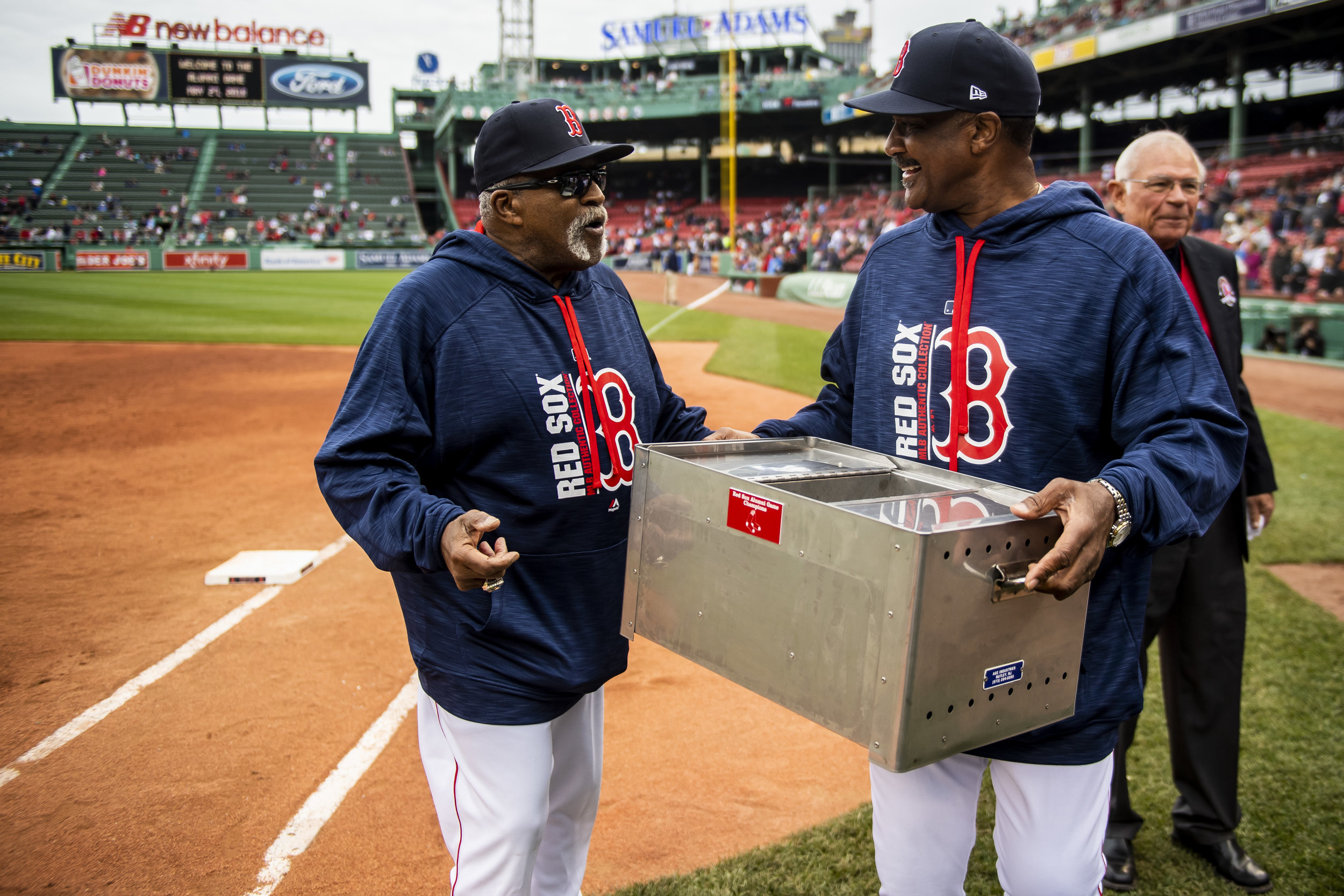 May 27, 2018, Boston, MA: Jim Rice presents Luis Tiant with the Alumni Game trophy after the game at Fenway Park in Boston, Massachusetts on Sunday, May 27, 2018. (Photo by Matthew Thomas/Boston Red Sox)