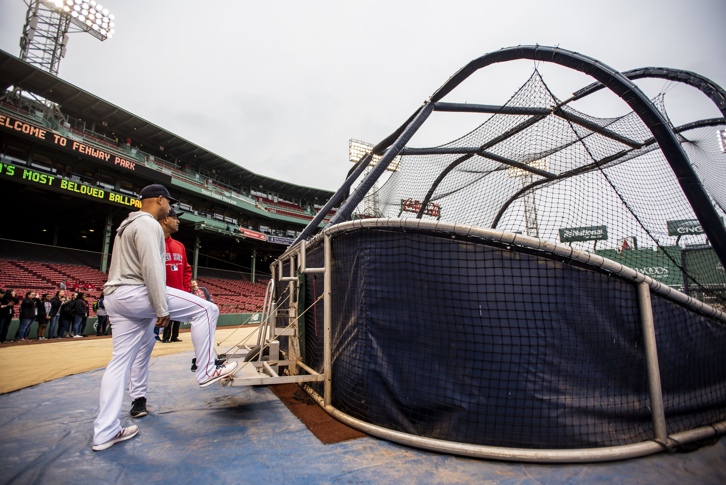 May 27, 2018, Boston, MA: Red Sox Manager Alex Cora chats with Julio Lugo during batting practice before the Red Sox Alumni Game at Fenway Park in Boston, Massachusetts on Sunday, May 27, 2018. (Photo by Matthew Thomas/Boston Red Sox)