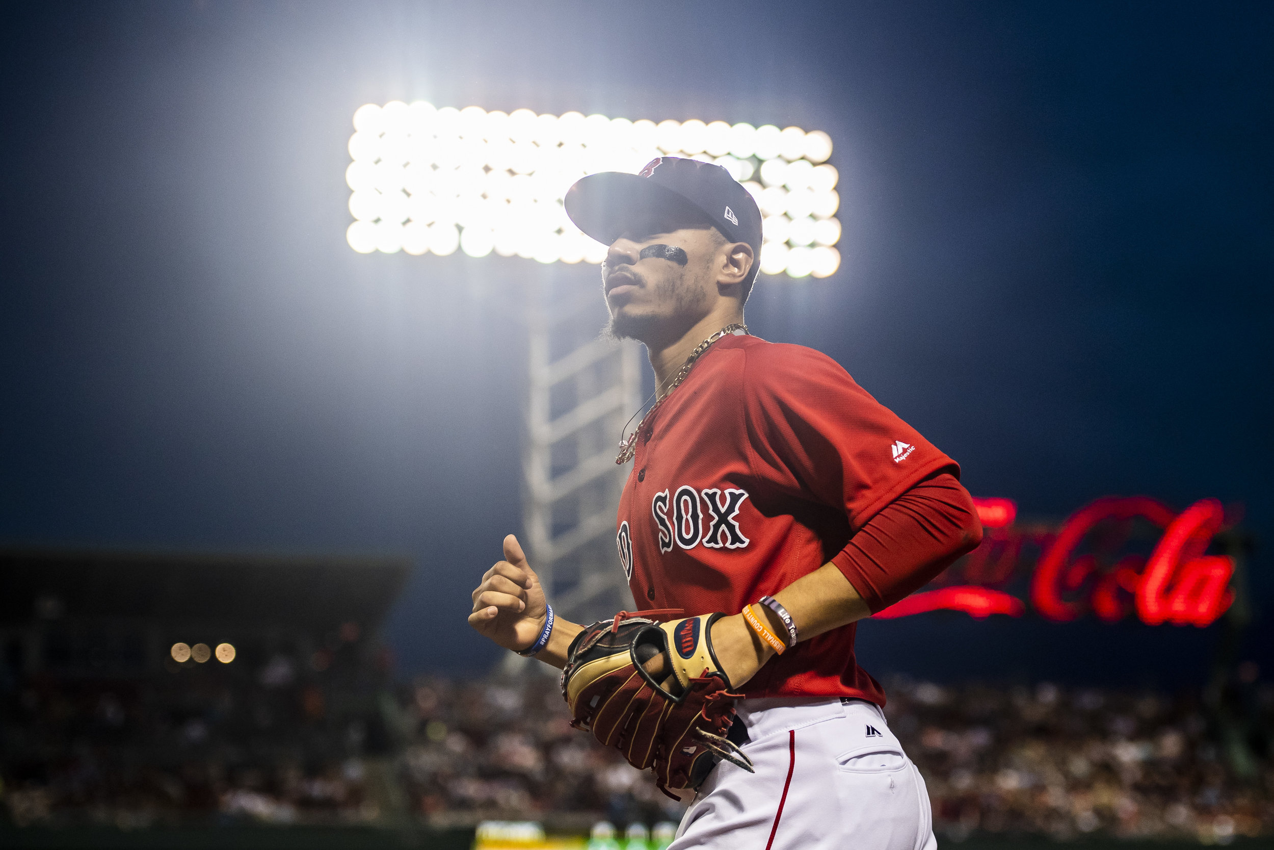 May 25, 2018, Boston, MA: Boston Red Sox outfielder Mookie Betts jogs off the field after the final out of the inning as the Boston Red Sox face the Atlanta Braves at Fenway Park in Boston, Massachusetts on Friday, May 25, 2018. (Photo by Matthew Thomas/Boston Red Sox)