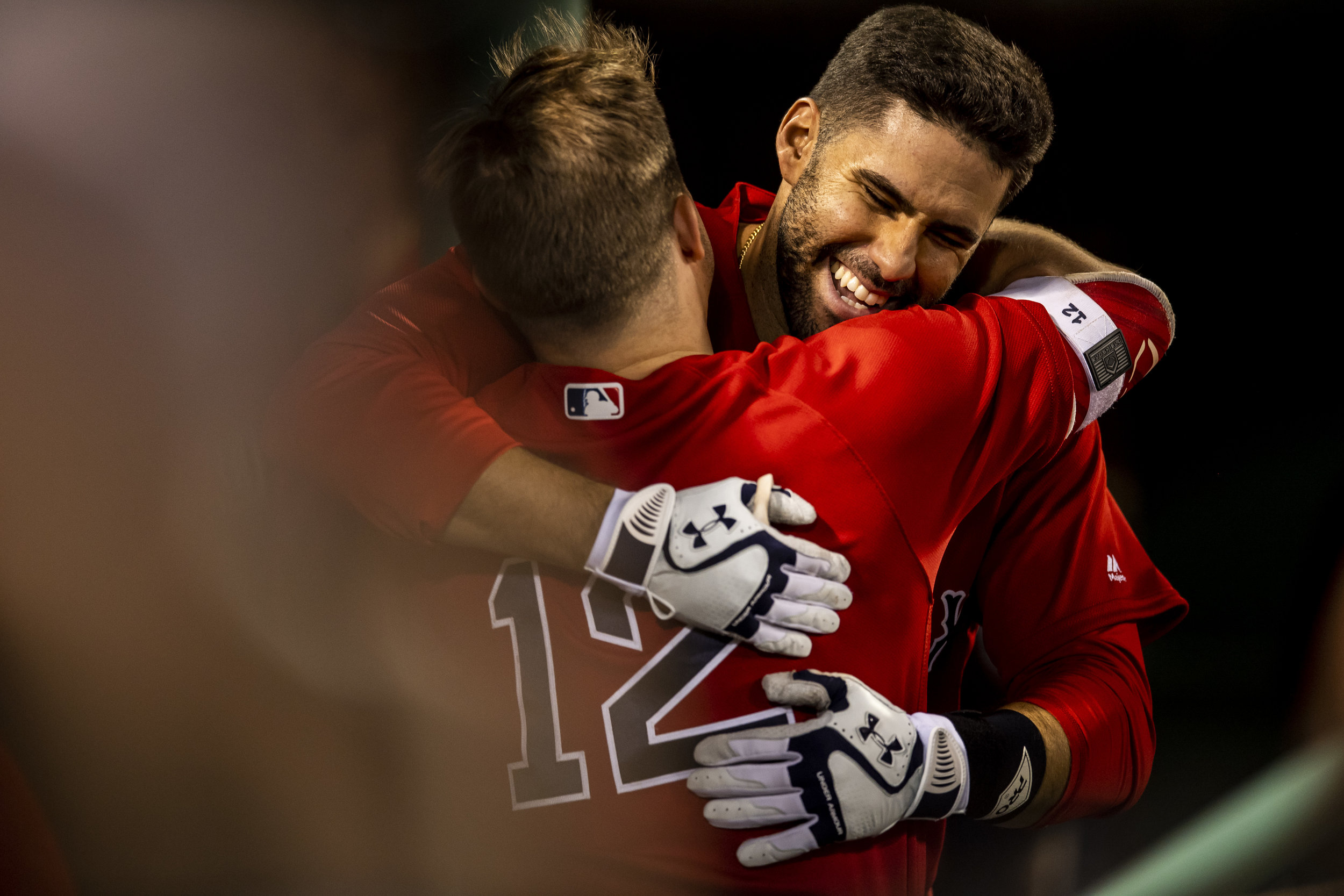 May 25, 2018, Boston, MA: Boston Red Sox designated hitter J.D. Martinez hugs Boston Red Sox outfielder Brock Holt after he makes his way back into the dugout after hitting a home run as the Boston Red Sox face the Atlanta Braves at Fenway Park in Boston, Massachusetts on Friday, May 25, 2018. (Photo by Matthew Thomas/Boston Red Sox)