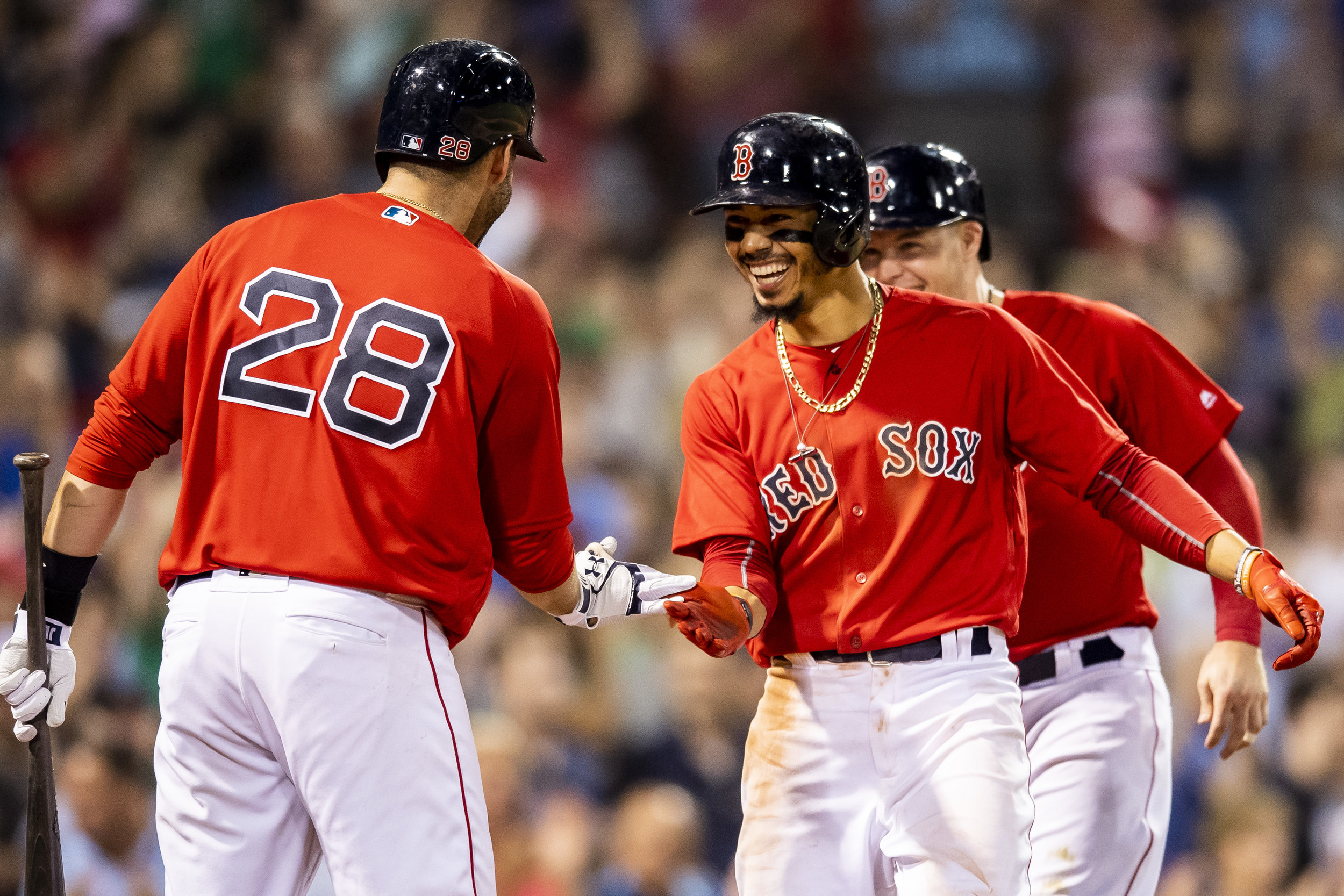 May 25, 2018, Boston, MA: Boston Red Sox outfielder Mookie Betts high-fives Boston Red Sox designated hitter J.D. Martinez after hitting a home run as the Boston Red Sox face the Atlanta Braves at Fenway Park in Boston, Massachusetts on Friday, May 25, 2018. (Photo by Matthew Thomas/Boston Red Sox)