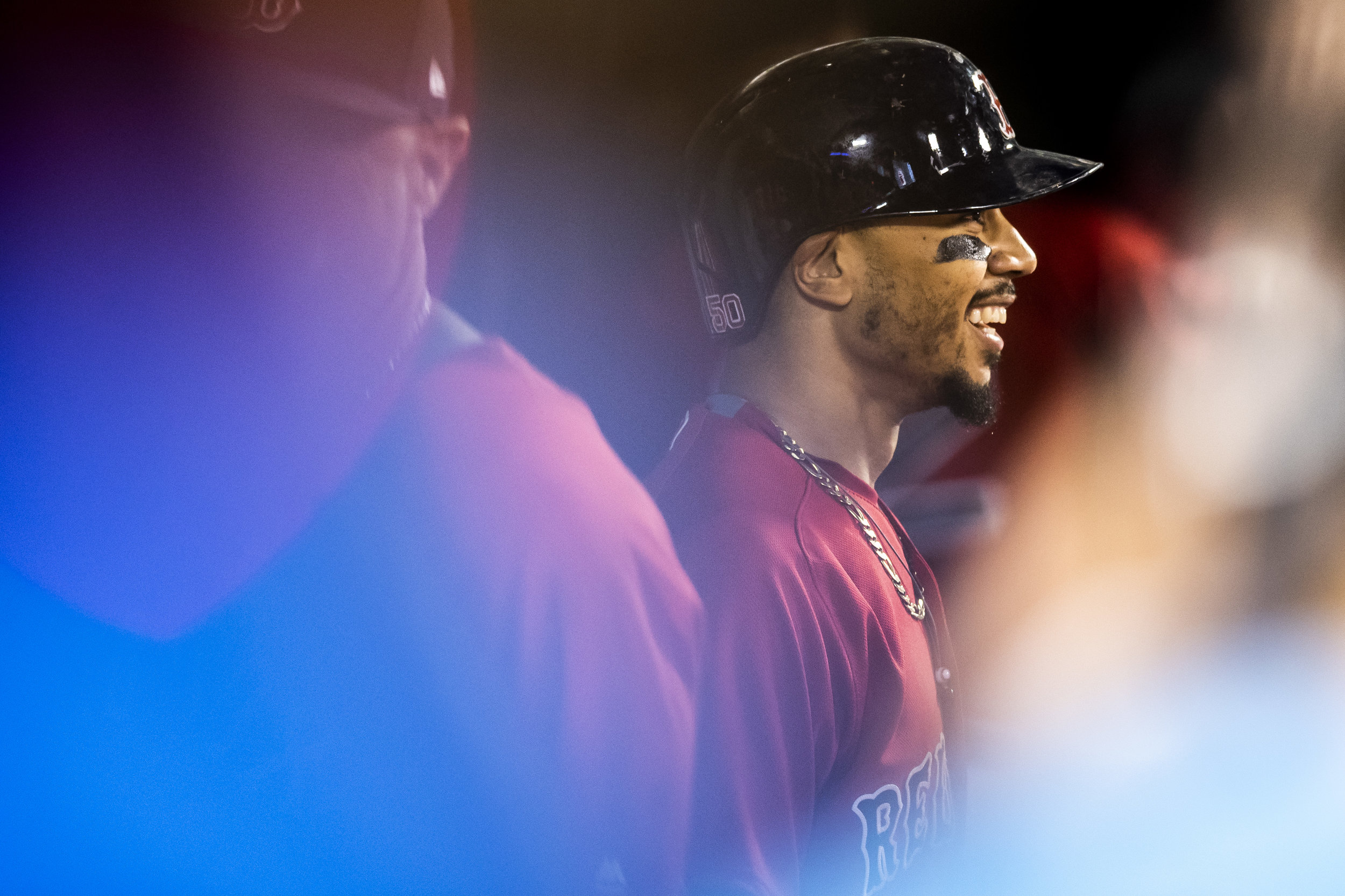 May 25, 2018, Boston, MA: Boston Red Sox outfielder Mookie Betts cracks a smile in the dugout after hitting a home run as the Boston Red Sox face the Atlanta Braves at Fenway Park in Boston, Massachusetts on Friday, May 25, 2018. (Photo by Matthew Thomas/Boston Red Sox)