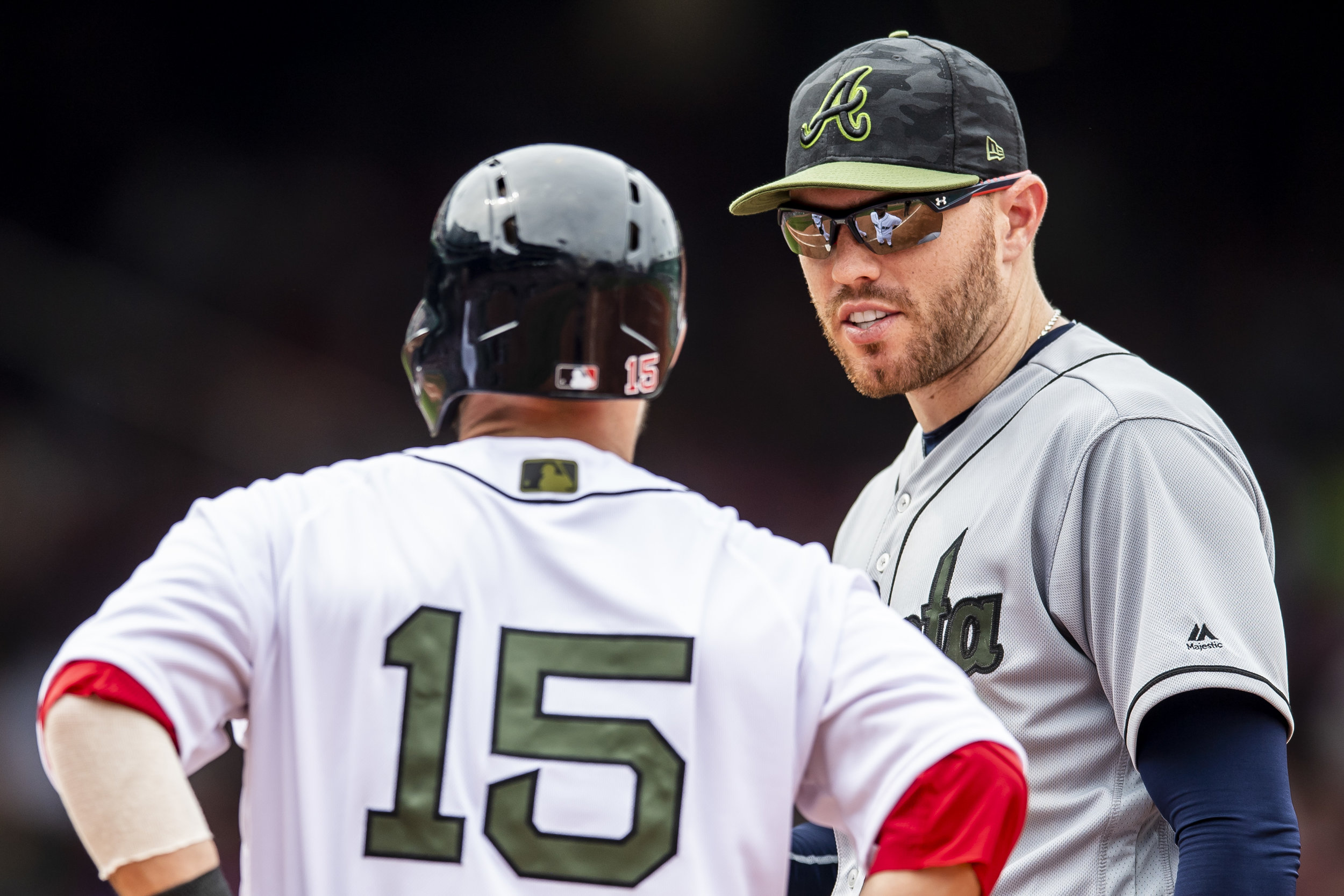 May 26, 2018, Boston, MA: Atlanta Braves first basemen Freddie Freeman chats with Boston Red Sox second basemen Dustin Pedroia as the Boston Red Sox face the Atlanta Braves at Fenway Park in Boston, Massachusetts on Saturday, May 26, 2018. (Photo by Matthew Thomas/Boston Red Sox)