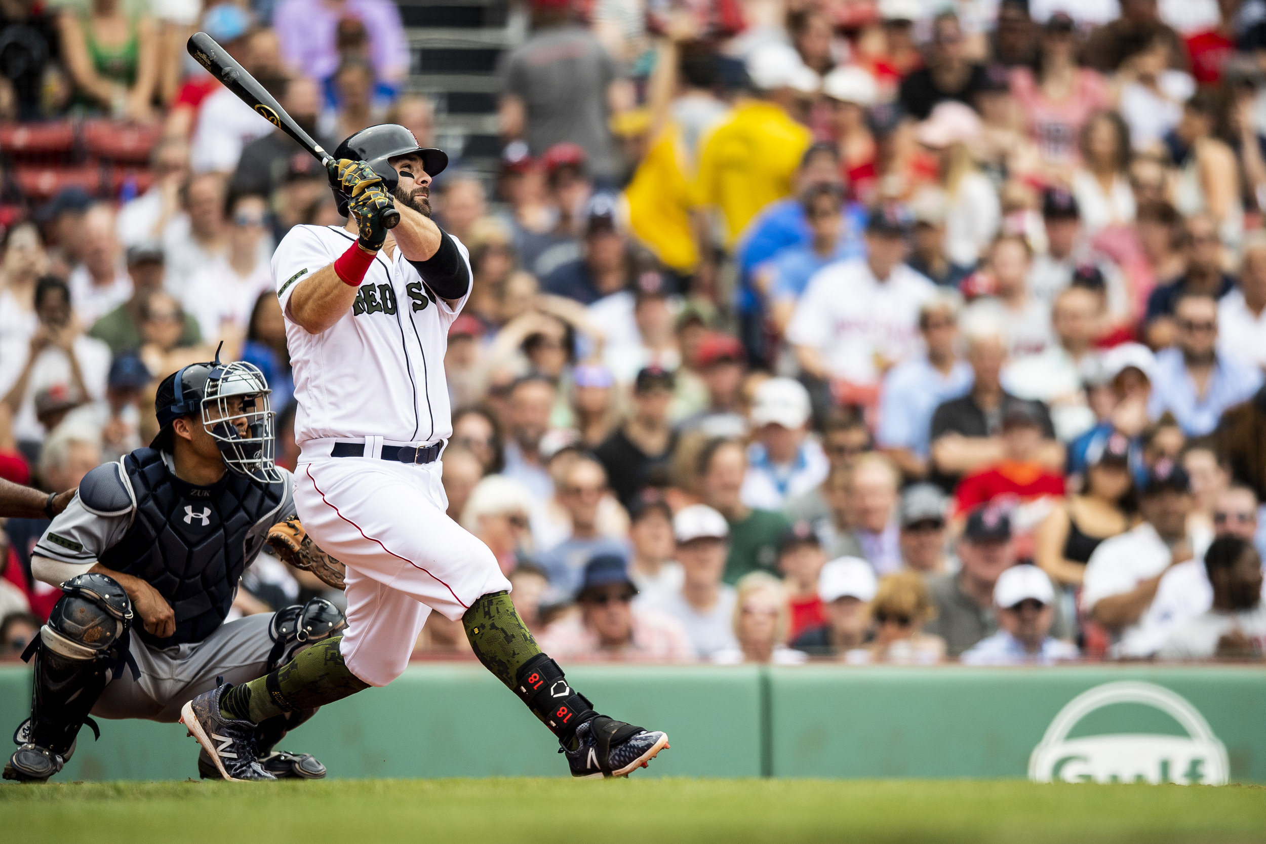 May 26, 2018, Boston, MA: Boston Red Sox first basemen Mitch Moreland swings at a pitch as the Boston Red Sox face the Atlanta Braves at Fenway Park in Boston, Massachusetts on Saturday, May 26, 2018. (Photo by Matthew Thomas/Boston Red Sox)