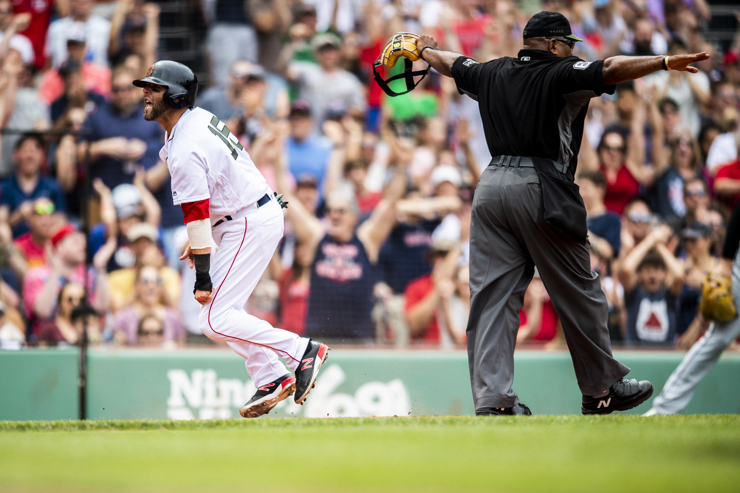May 26, 2018, Boston, MA: Boston Red Sox second basemen Dustin Pedroia safely scores as the Boston Red Sox face the Atlanta Braves at Fenway Park in Boston, Massachusetts on Saturday, May 26, 2018. (Photo by Matthew Thomas/Boston Red Sox)