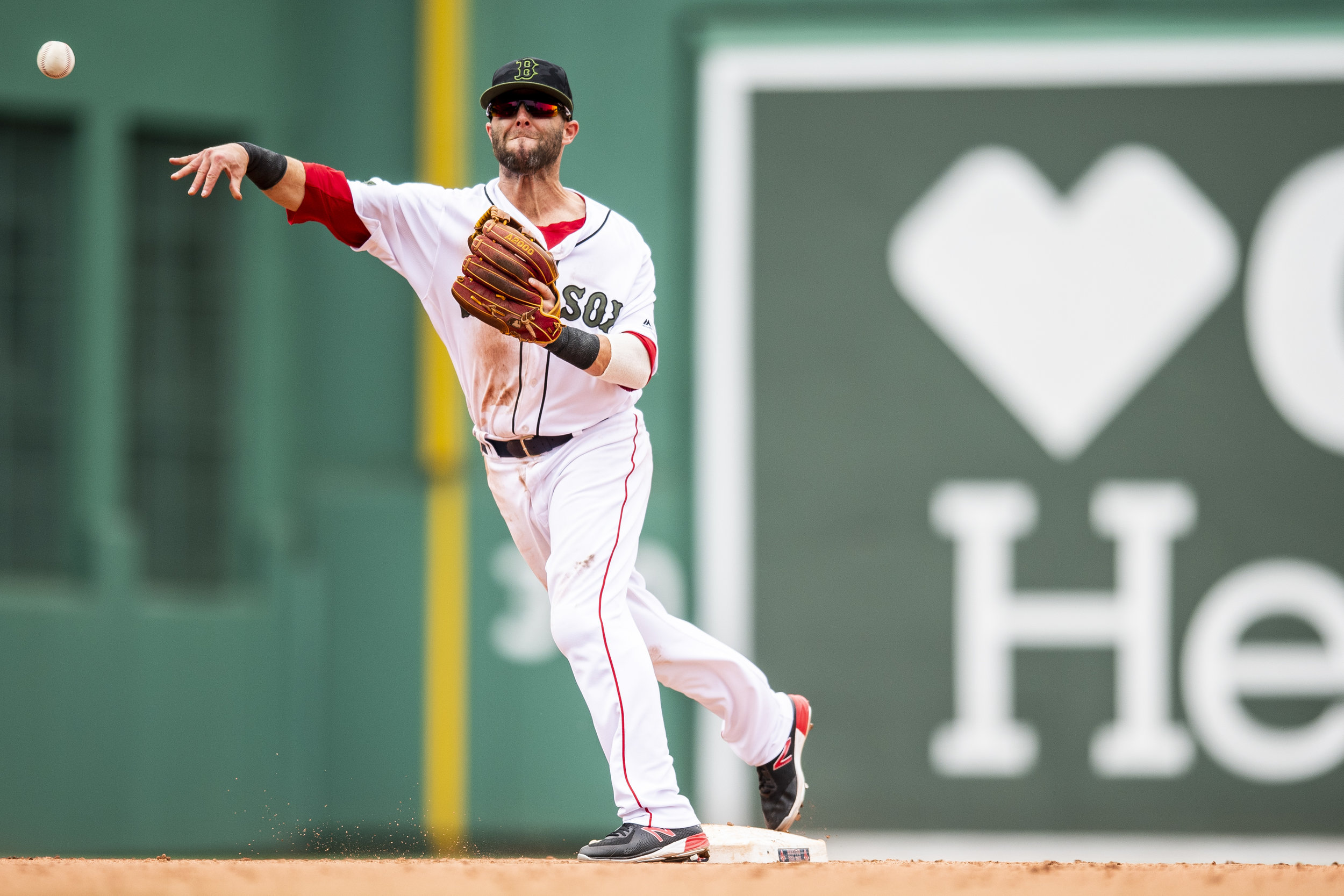 May 26, 2018, Boston, MA: Boston Red Sox second basemen Dustin Pedroia throws the ball from second base turning a double play as the Boston Red Sox face the Atlanta Braves at Fenway Park in Boston, Massachusetts on Saturday, May 26, 2018. (Photo by Matthew Thomas/Boston Red Sox)