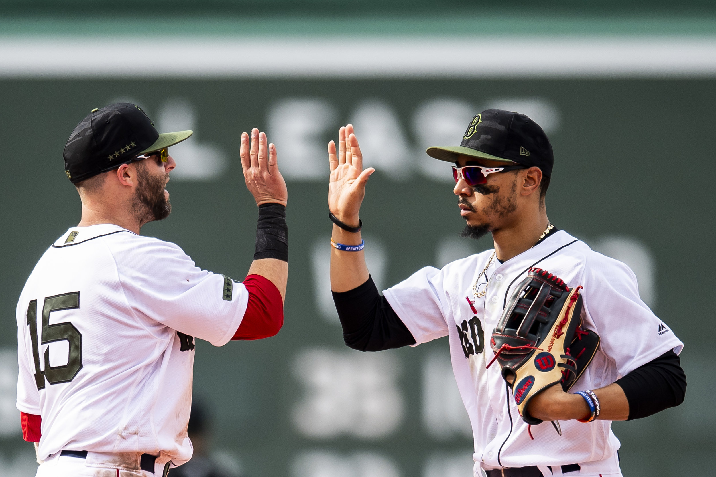 May 26, 2018, Boston, MA: Boston Red Sox second basemen Dustin Pedroia and Boston Red Sox outfielder Mookie Betts high-fives after  the Boston Red Sox defeated the Atlanta Braves at Fenway Park in Boston, Massachusetts on Saturday, May 26, 2018. (Photo by Matthew Thomas/Boston Red Sox)