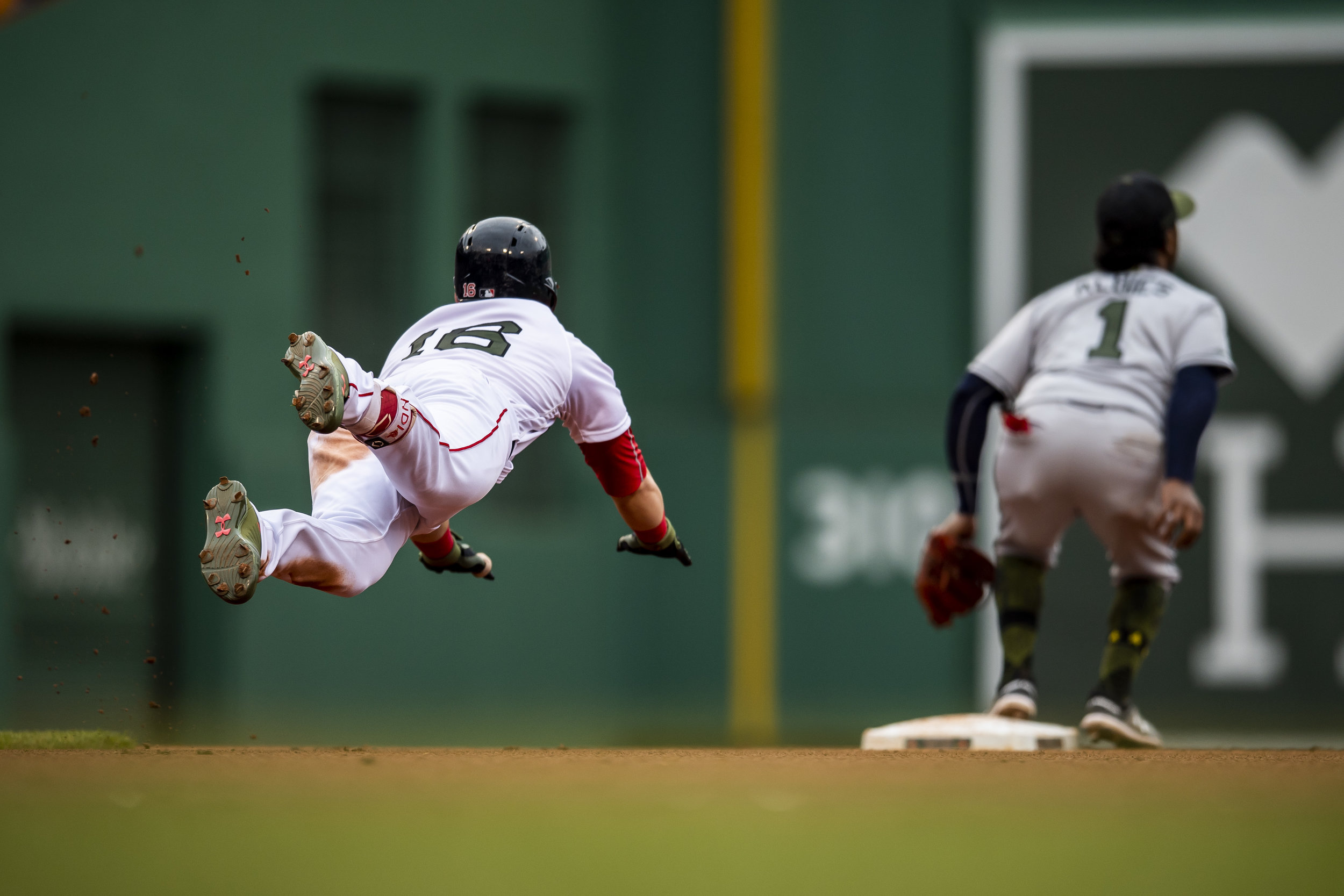 May 27, 2018, Boston, MA: Boston Red Sox outfielder Andrew Benintendi dives head first into second base for a double as the Boston Red Sox face the Atlanta Braves at Fenway Park in Boston, Massachusetts on Sunday, May 27, 2018. (Photo by Matthew Thomas/Boston Red Sox)
