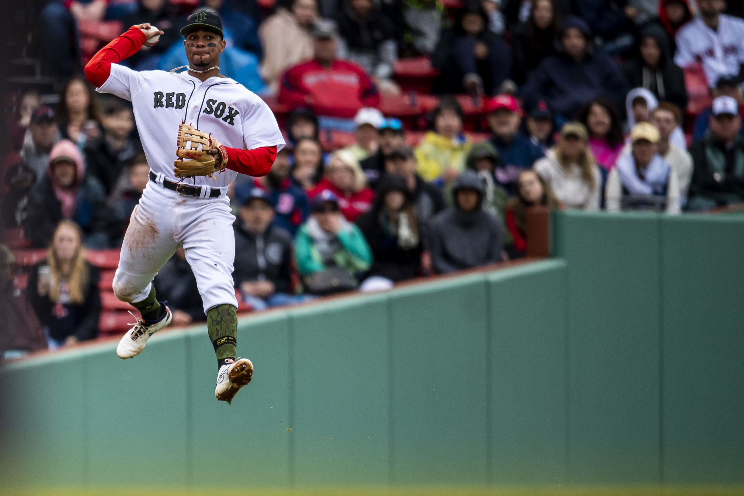 May 27, 2018, Boston, MA: Boston Red Sox shortstop Xander Bogaerts jumps to make a throw as the Boston Red Sox face the Atlanta Braves at Fenway Park in Boston, Massachusetts on Sunday, May 27, 2018. (Photo by Matthew Thomas/Boston Red Sox)