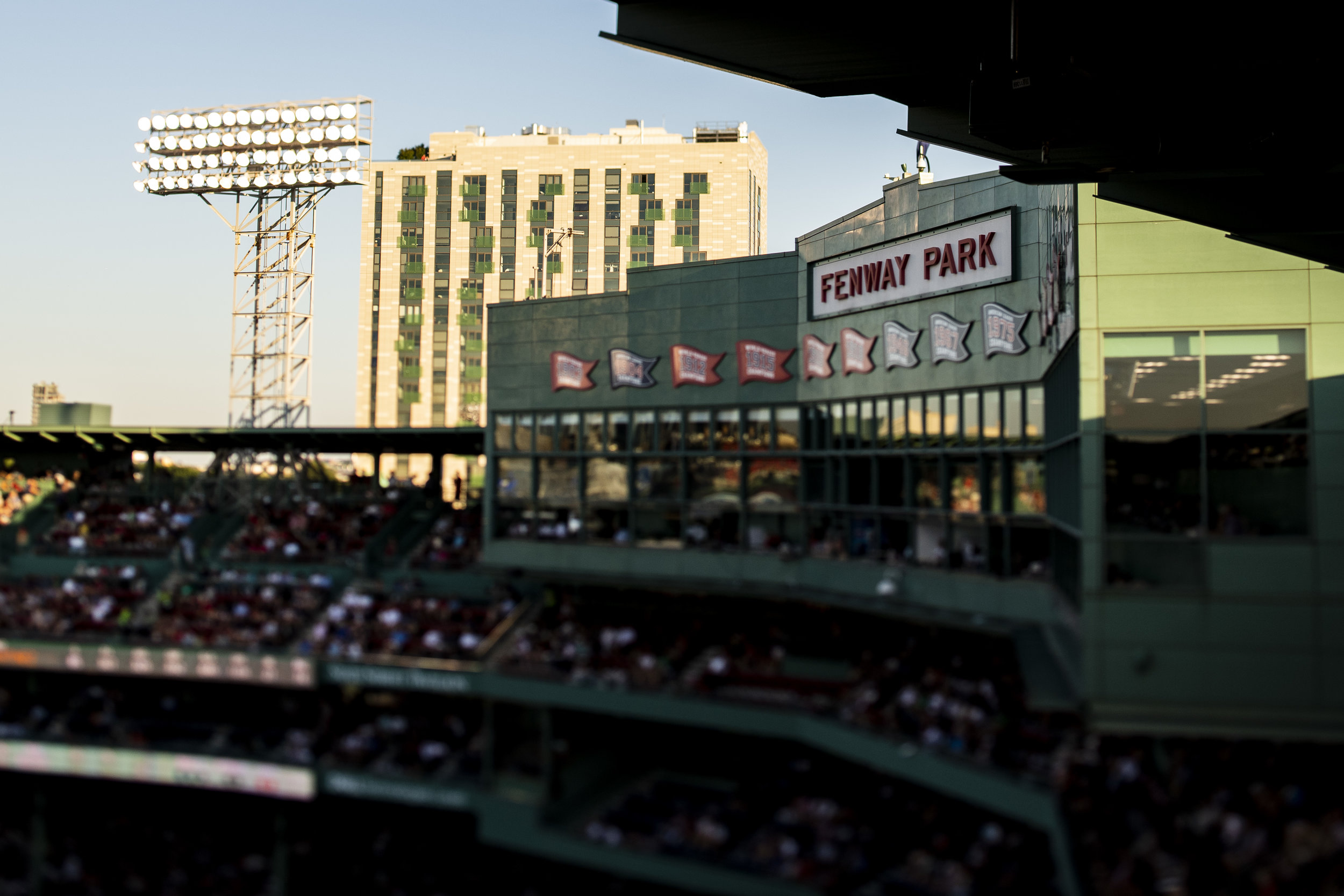 July 8, 2018, Boston, MA: The sun sets behind the facade  as the Boston Red Sox face the Texas Rangers Fenway Park in Boston, Massachusetts on Monday, July 9, 2018. (Photo by Matthew Thomas/Boston Red Sox)