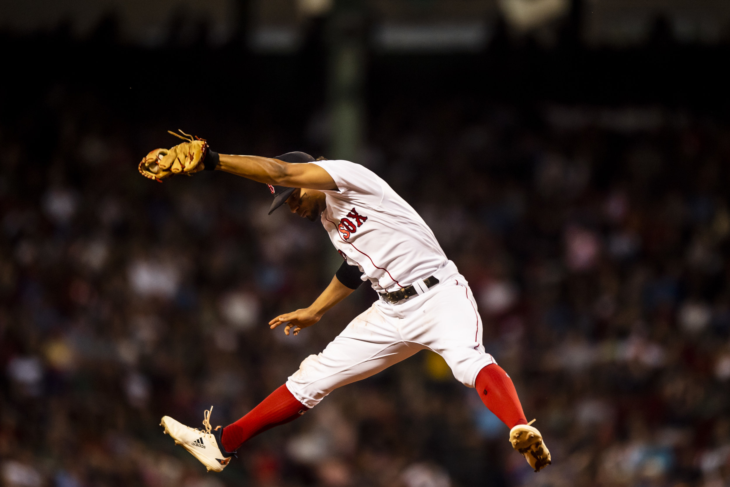 July 8, 2018, Boston, MA: Boston Red Sox shortstop Xander Bogaerts leaps into the air to make a catch as the Boston Red Sox face the Texas Rangers Fenway Park in Boston, Massachusetts on Monday, July 9, 2018. (Photo by Matthew Thomas/Boston Red Sox)