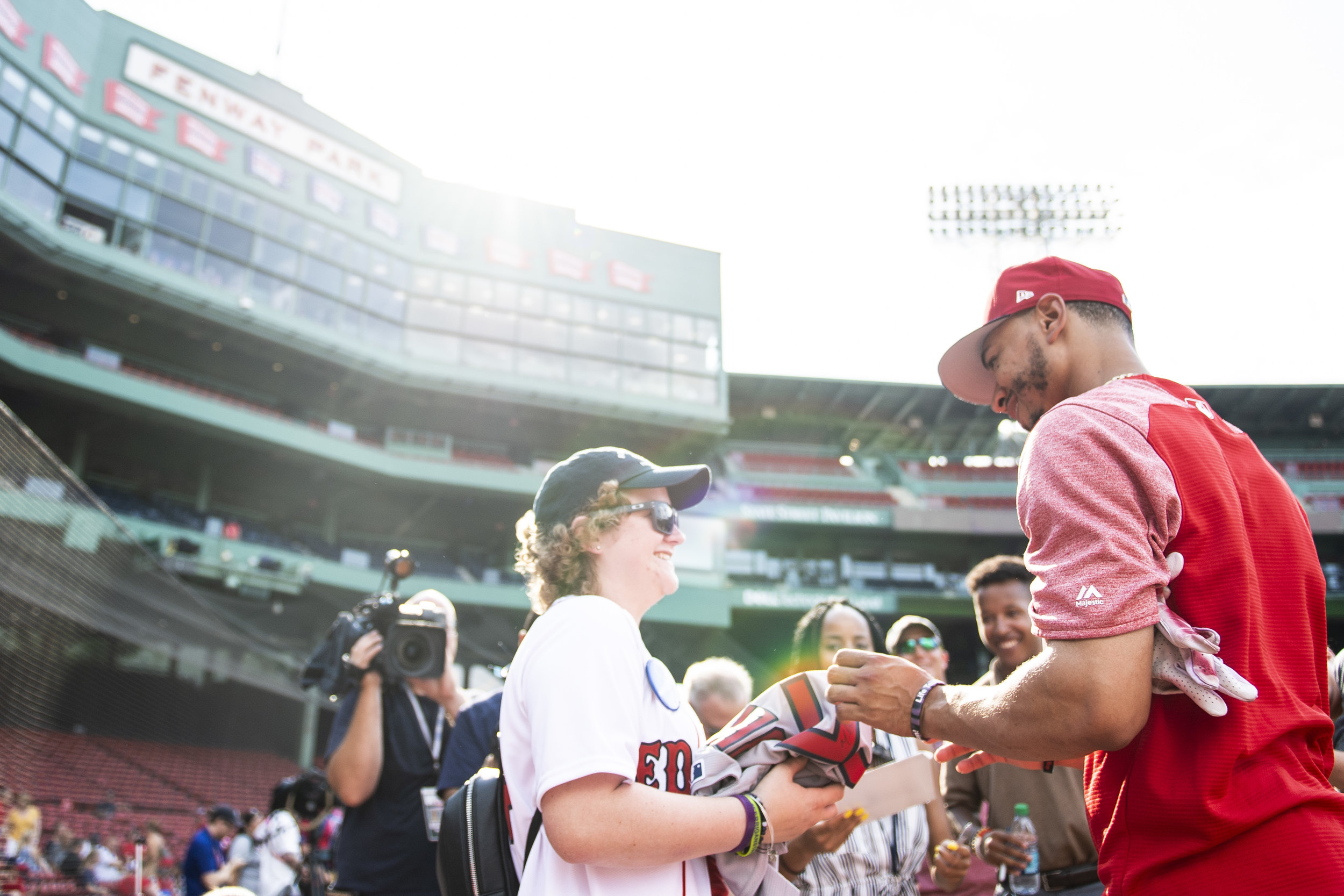 July 26, 2018, Boston, MA: Boston Red Sox outfielder Mookie Betts signs an autograph for a Make-A-Wish participant before the Boston Red Sox face the Minnesota Twins at Fenway Park in Boston, Massachusetts on Friday, July 27, 2018. (Photo by Matthew Thomas/Boston Red Sox)
