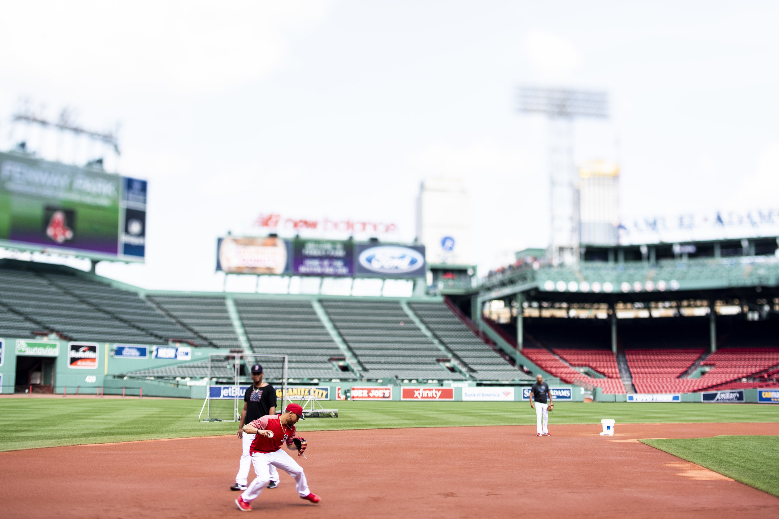 July 26, 2018, Boston, MA: Boston Red Sox outfielder Mookie Betts fields a ball at third base during warmups before the Boston Red Sox face the Minnesota Twins at Fenway Park in Boston, Massachusetts on Friday, July 27, 2018. (Photo by Matthew Thomas/Boston Red Sox)