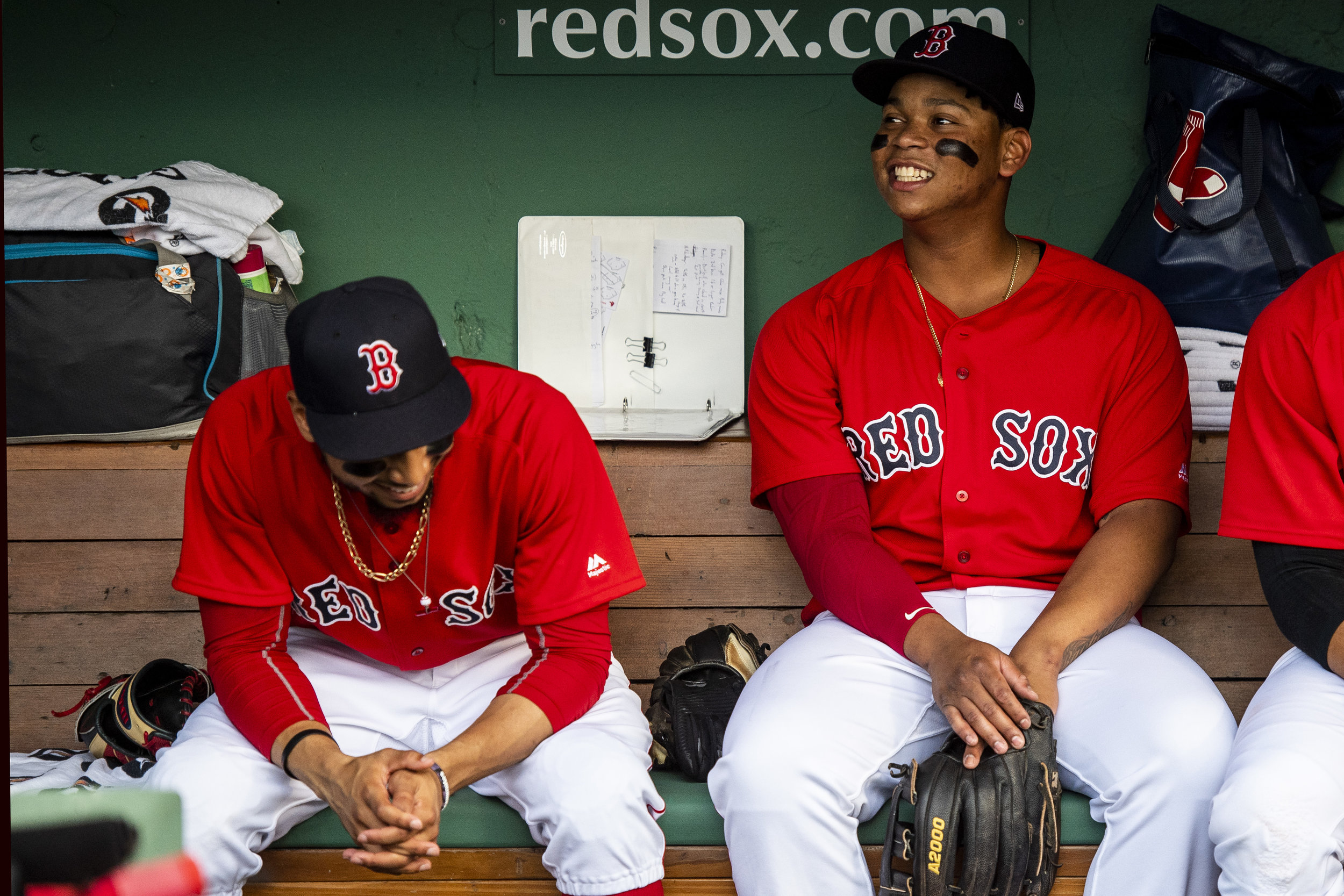 July 26, 2018, Boston, MA: Boston Red Sox outfielder Mookie Betts, Boston Red Sox third basemen Rafael Devers and Boston Red Sox shortstop Xander Bogaerts hang out int he dugout before the Boston Red Sox face the Minnesota Twins at Fenway Park in Boston, Massachusetts on Friday, July 27, 2018. (Photo by Matthew Thomas/Boston Red Sox)
