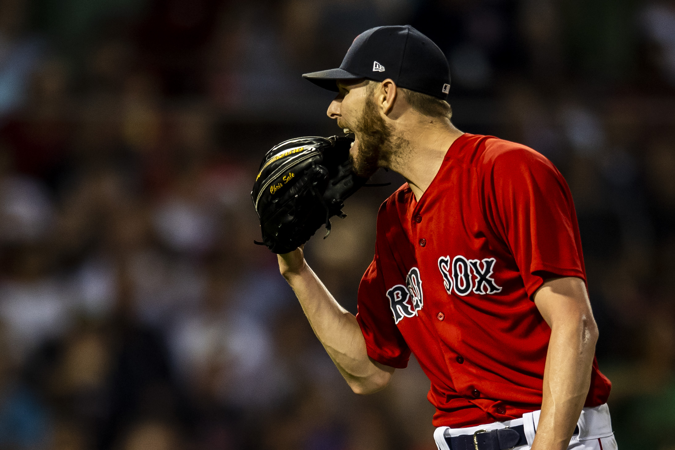 July 26, 2018, Boston, MA: Boston Red Sox pitcher Chris Sale screams into his glove as the Boston Red Sox face the Minnesota Twins at Fenway Park in Boston, Massachusetts on Friday, July 27, 2018. (Photo by Matthew Thomas/Boston Red Sox)