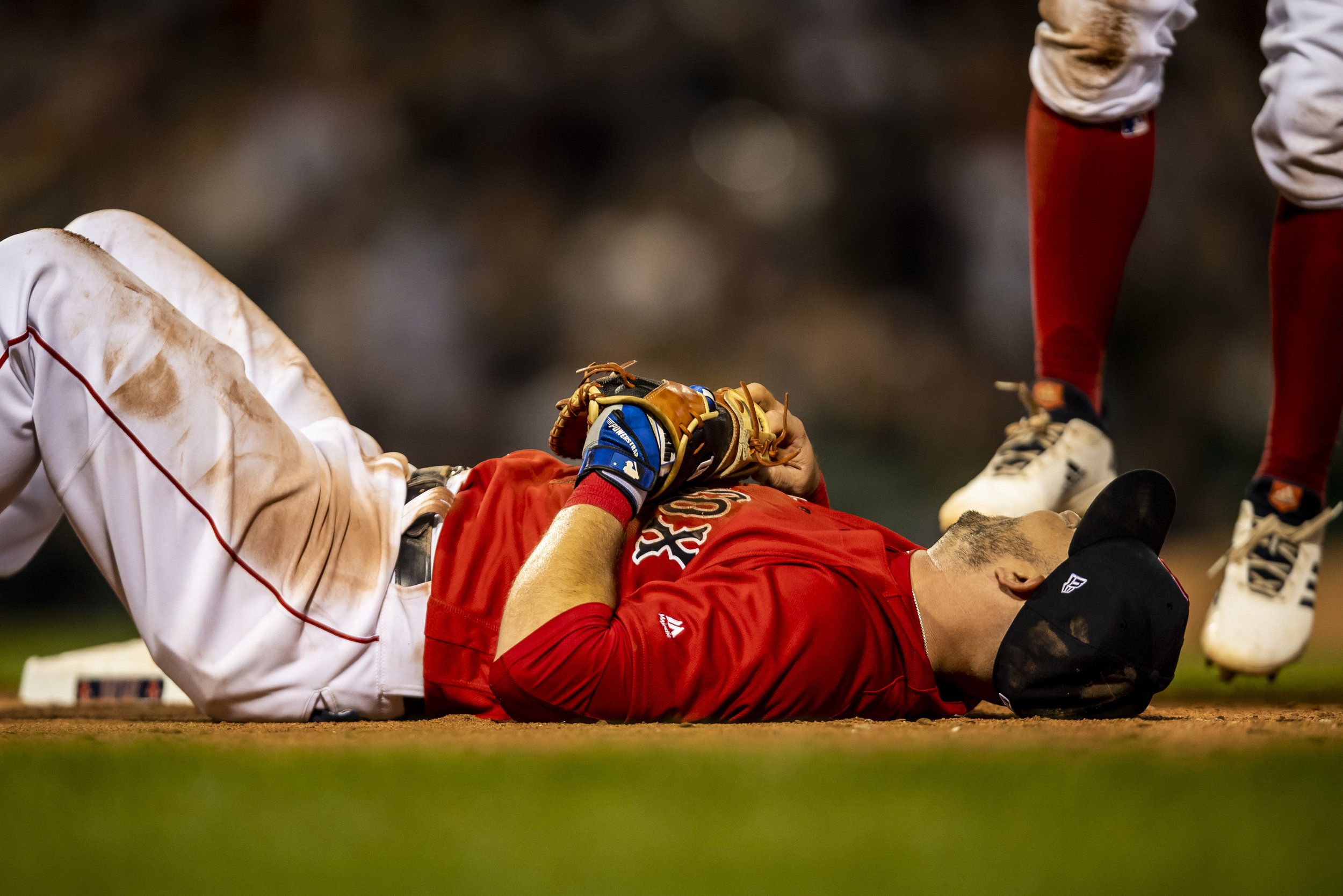 July 26, 2018, Boston, MA: Boston Red Sox infielder Steve Pearce lays on his back after making a play at first base as the Boston Red Sox face the Minnesota Twins at Fenway Park in Boston, Massachusetts on Friday, July 27, 2018. (Photo by Matthew Thomas/Boston Red Sox)