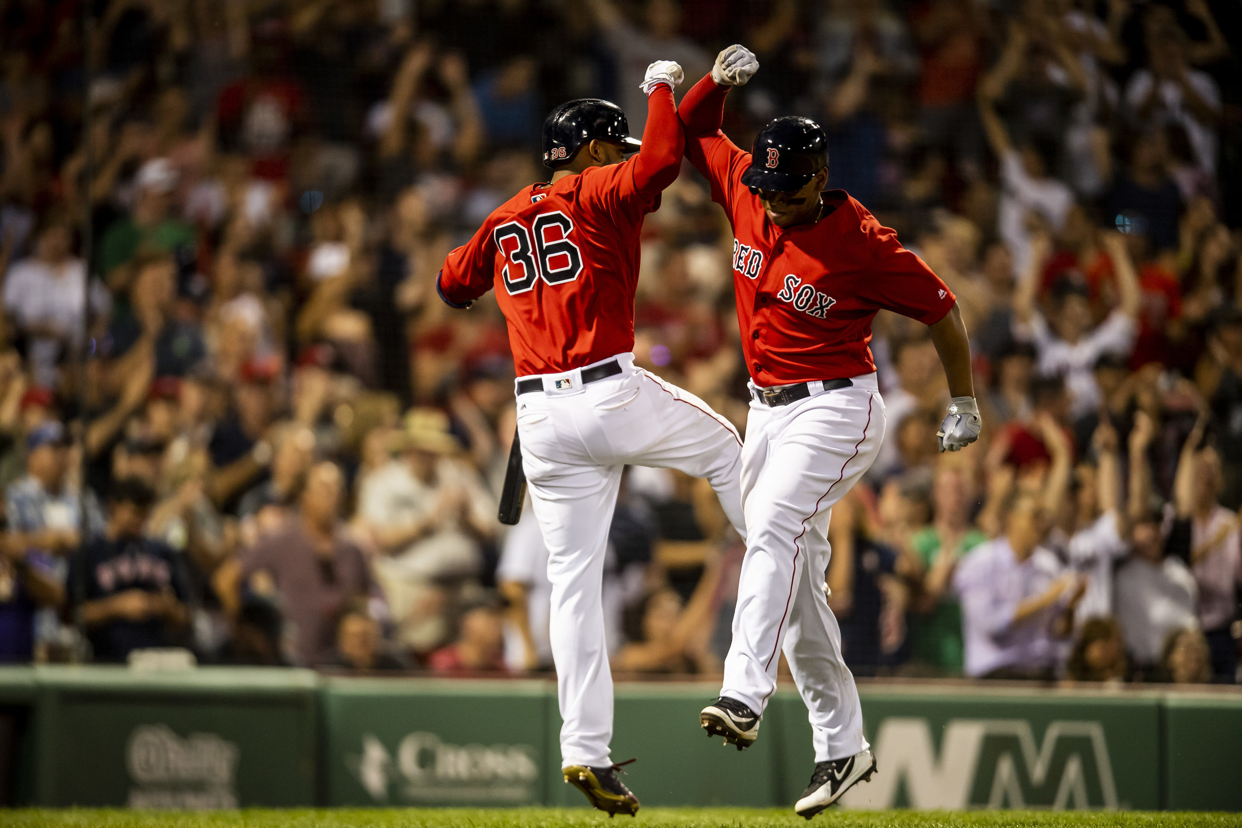 July 26, 2018, Boston, MA: Boston Red Sox third basemen Rafael Devers and Boston Red Sox second basemen Eduardo Nunez celebrate Devers home run as the Boston Red Sox face the Minnesota Twins at Fenway Park in Boston, Massachusetts on Friday, July 27, 2018. (Photo by Matthew Thomas/Boston Red Sox)