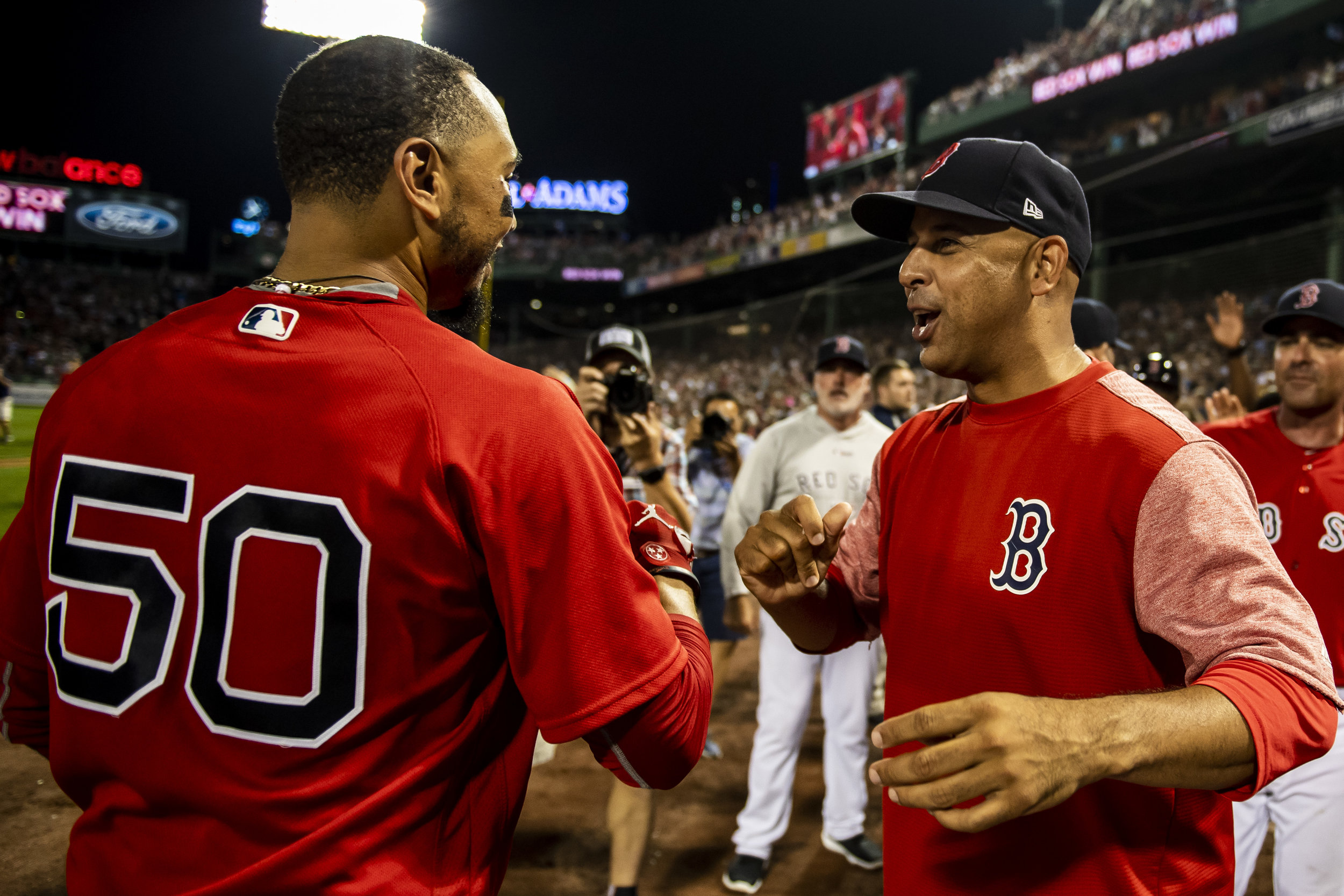 July 26, 2018, Boston, MA: Boston Red Sox outfielder Mookie Betts and Manager Alex Cora celebrate after Betts hits the walk-off home run as the Boston Red Sox defeated the Minnesota Twins at Fenway Park in Boston, Massachusetts on Friday, July 27, 2018. (Photo by Matthew Thomas/Boston Red Sox)