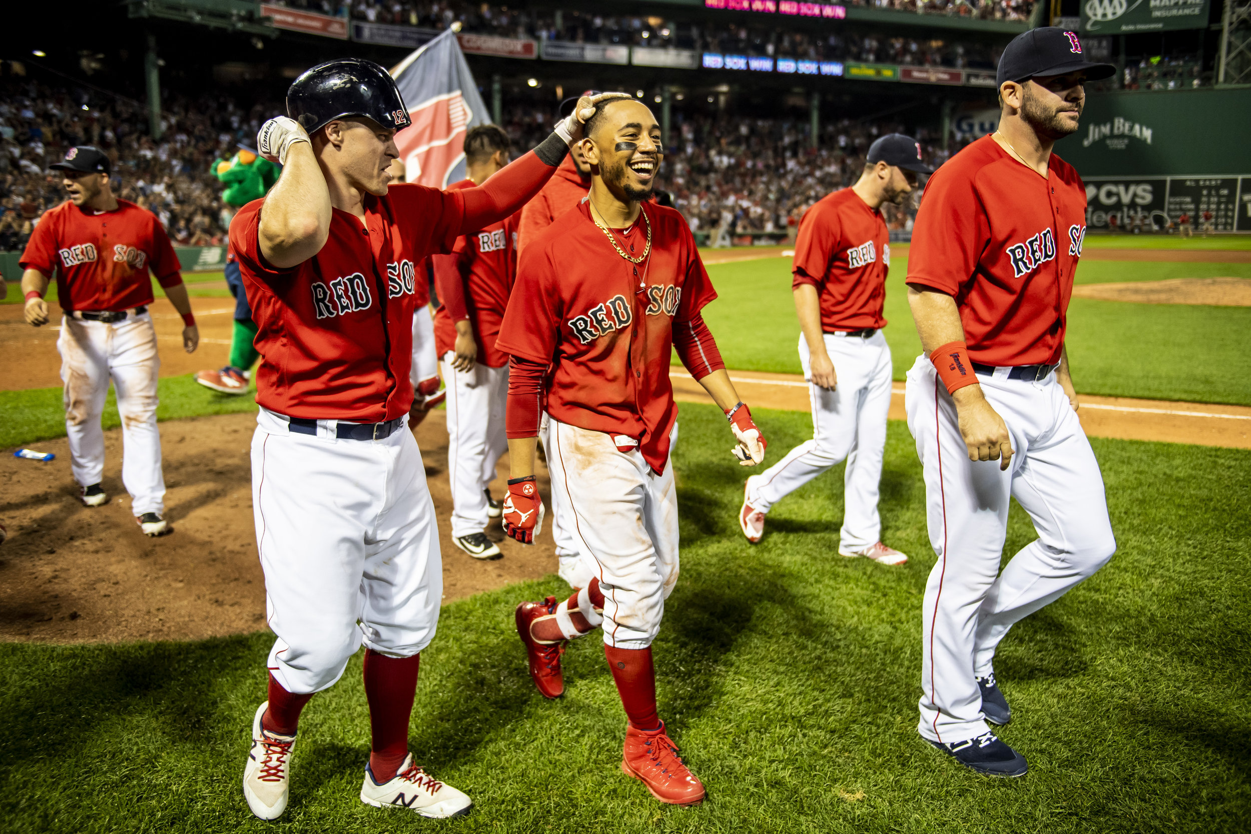 July 26, 2018, Boston, MA: Boston Red Sox outfielder Brock Holt and Boston Red Sox outfielder Mookie Betts walk off the field after Bett's walk-off home run as the Boston Red Sox defeated the Minnesota Twins at Fenway Park in Boston, Massachusetts on Friday, July 27, 2018. (Photo by Matthew Thomas/Boston Red Sox)