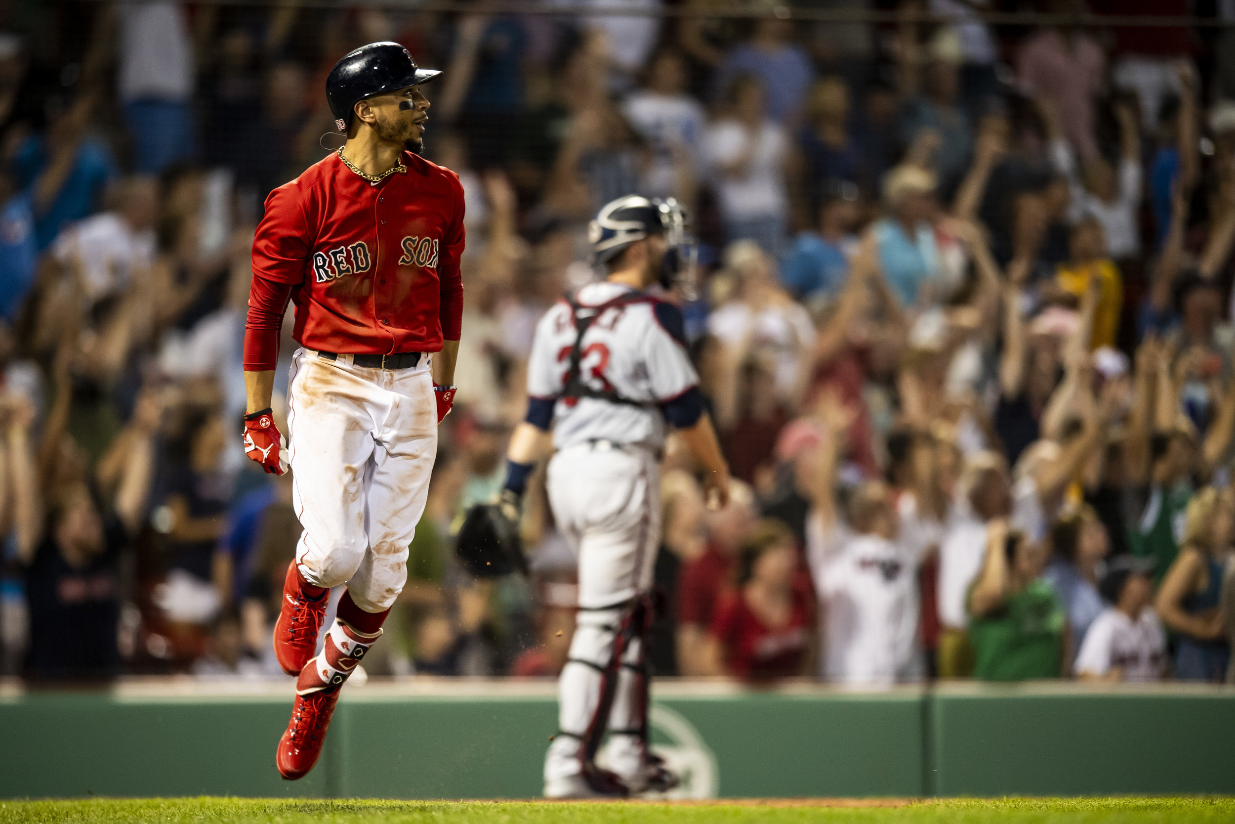 July 26, 2018, Boston, MA: Boston Red Sox outfielder Mookie Betts hits the walk-off home run as the Boston Red Sox defeated the Minnesota Twins at Fenway Park in Boston, Massachusetts on Friday, July 27, 2018. (Photo by Matthew Thomas/Boston Red Sox)
