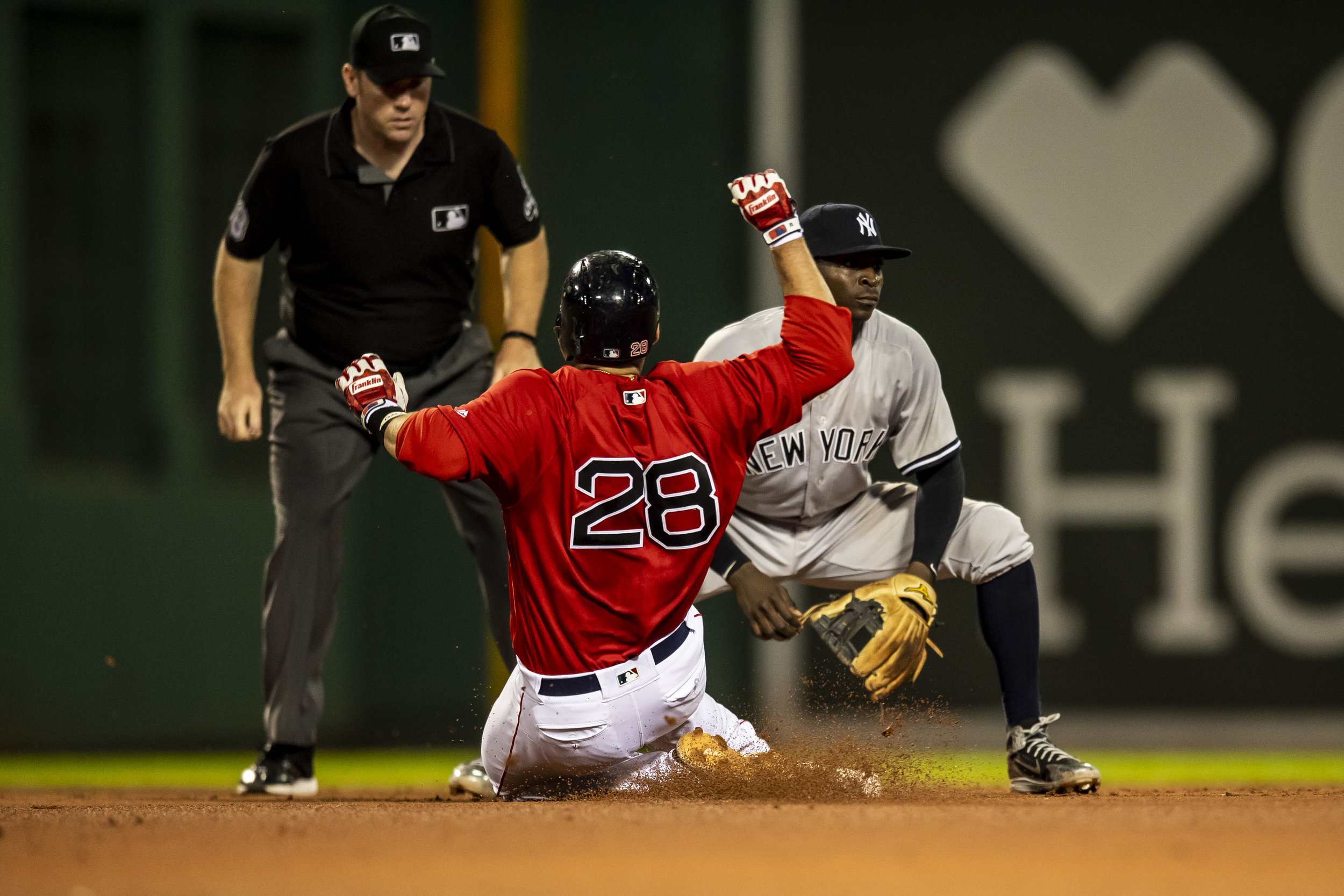 August 3, 2018, Boston, MA: Boston Red Sox outfielder J.D. Martinez  slides into second base as the Boston Red Sox face the New York Yankees at Fenway Park in Boston, Massachusetts on Friday, August 3, 2018. (Photo by Matthew Thomas/Boston Red Sox)