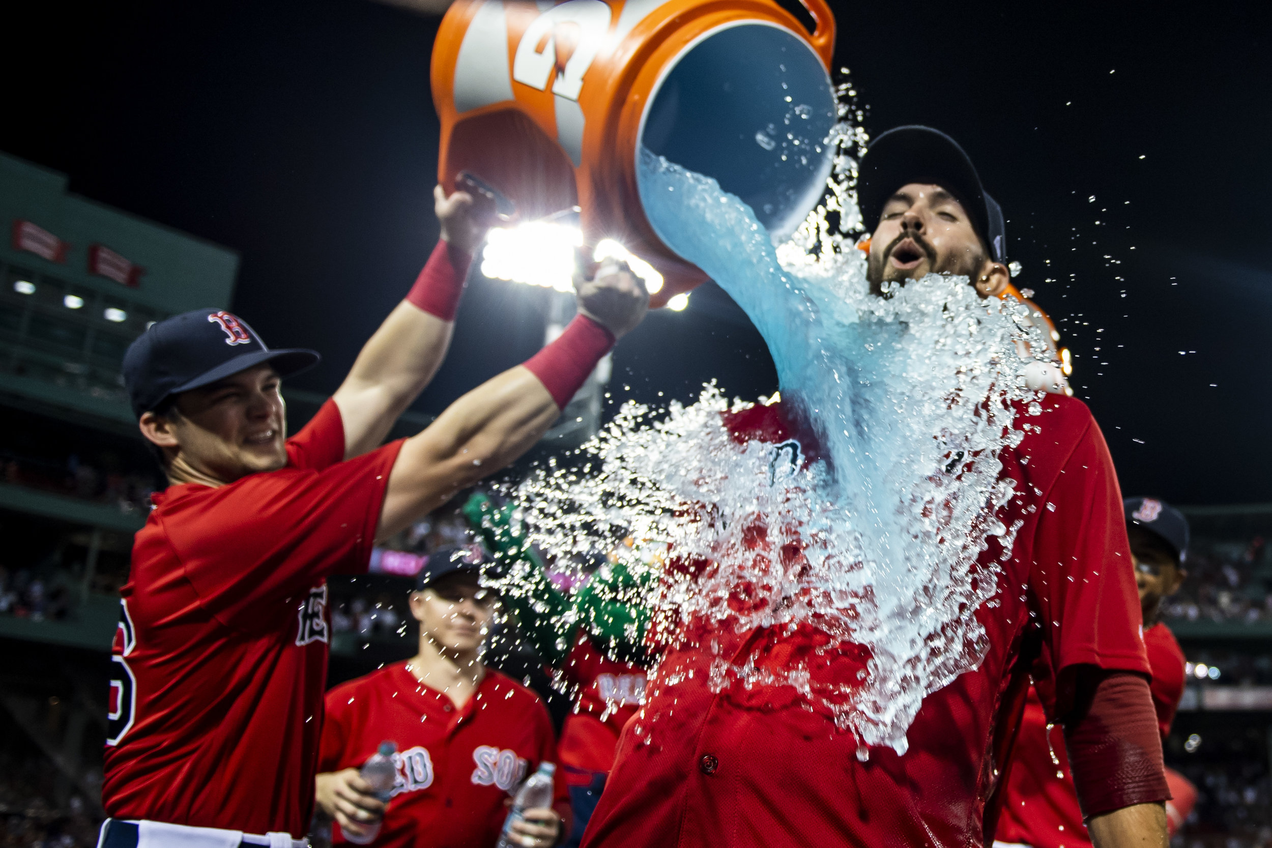 August 3, 2018, Boston, MA: Boston Red Sox outfielder Andrew Benintendi dumps a cooler of Gatorade on Boston Red Sox pitcher Rick Porcello after he pitched the complete game after the Boston Red Sox defeated the New York Yankees at Fenway Park in Boston, Massachusetts on Friday, August 3, 2018. (Photo by Matthew Thomas/Boston Red Sox)