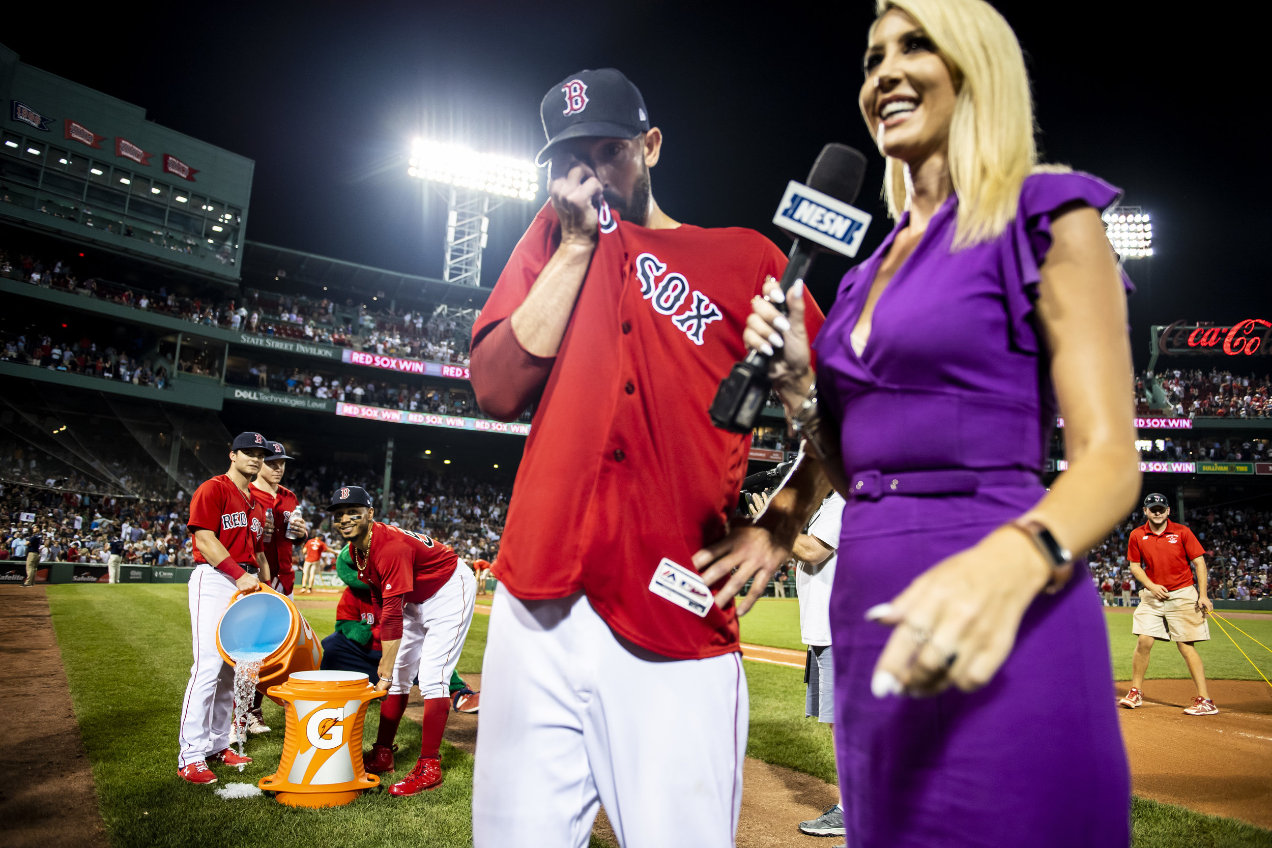 August 3, 2018, Boston, MA: Boston Red Sox outfielder Andrew Benintendi, Boston Red Sox outfielder Mookie Betts and Boston Red Sox outfielder Brock Holt wait to dump gatorade over Boston Red Sox pitcher Rick Porcello after his one hit complete game after the Boston Red Sox defeated the New York Yankees at Fenway Park in Boston, Massachusetts on Friday, August 3, 2018. (Photo by Matthew Thomas/Boston Red Sox)