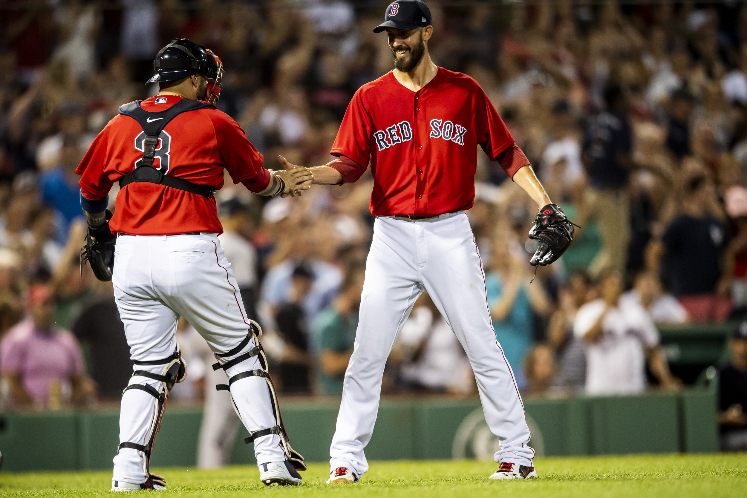 August 3, 2018, Boston, MA: Boston Red Sox pitcher Rick Porcello celebrates with Boston Red Sox catcher Sandy Leon after  pitching a one hit complete game after the Boston Red Sox defeated the New York Yankees at Fenway Park in Boston, Massachusetts on Friday, August 3, 2018. (Photo by Matthew Thomas/Boston Red Sox)