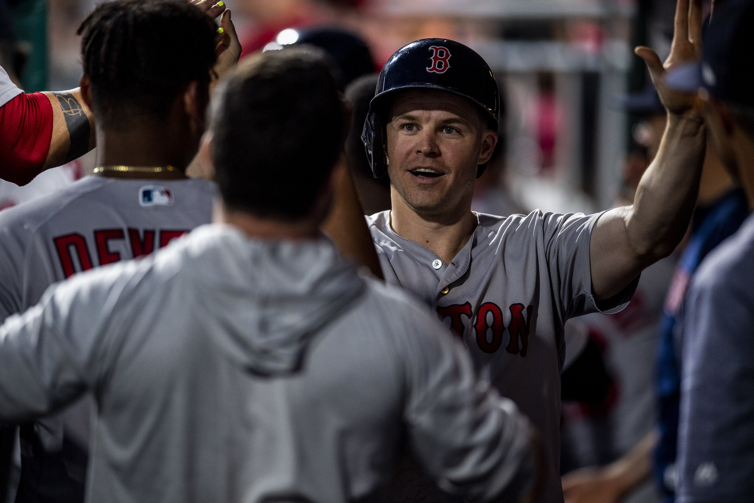 August 15, 2018, Philadelphia, PA: Boston Red Sox outfielder Brock Holt high-fives teammates in the dugout after scoring a run as the Boston Red Sox face the Philadelphia Phillies at Citizen Bank Park in Philadelphia, Pennsylvania on Wednesday, August 15, 2018. (Photo by Matthew Thomas/Boston Red Sox)